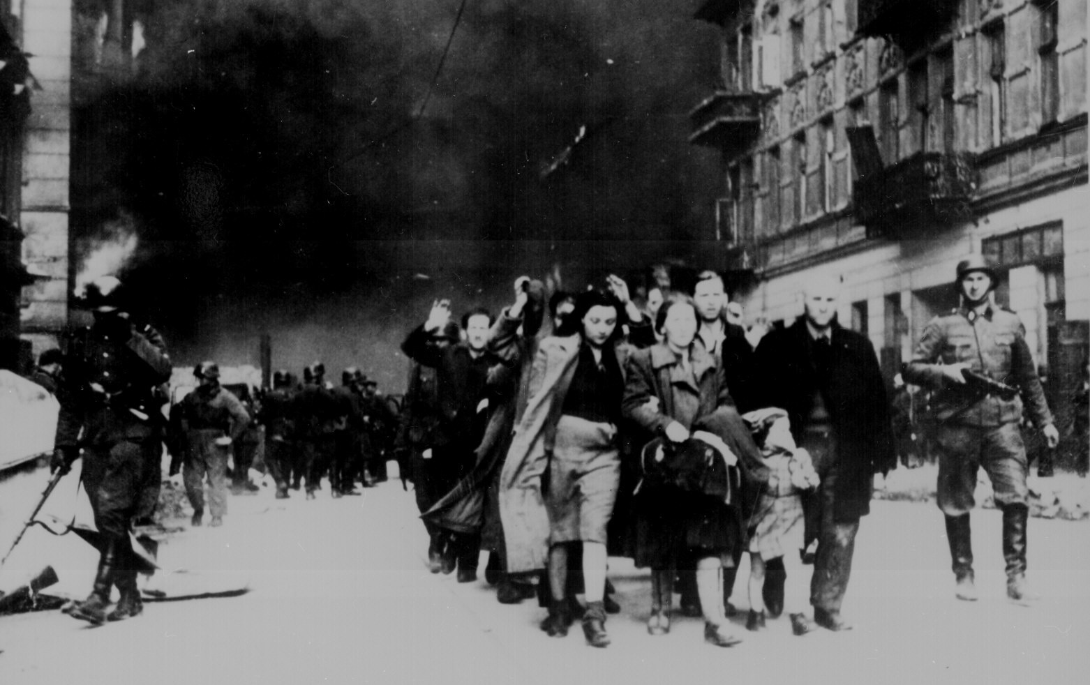 Jewish civilians are led down a street by German soldiers during the destruction of the Warsaw Ghetto, in Poland, 1943.    U.S. National Archives/via REUTERS   ATTENTION EDITORS - THIS IMAGE HAS BEEN SUPPLIED BY A THIRD PARTY - RC16EF750190