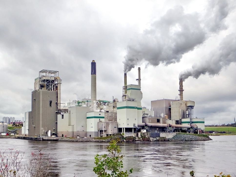 image of emissions coming from a factory building