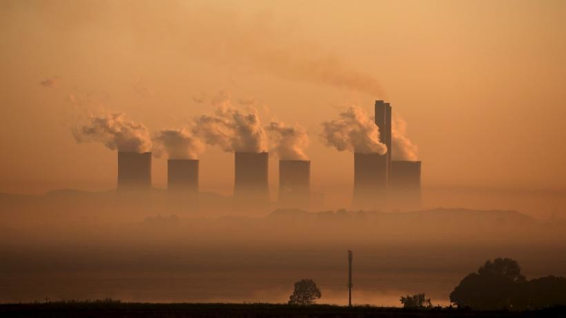 Steam rises at sunrise from the Lethabo Power Station, a coal-fired power station owned by state power utility Eskom near Sasolburg, South Africa,