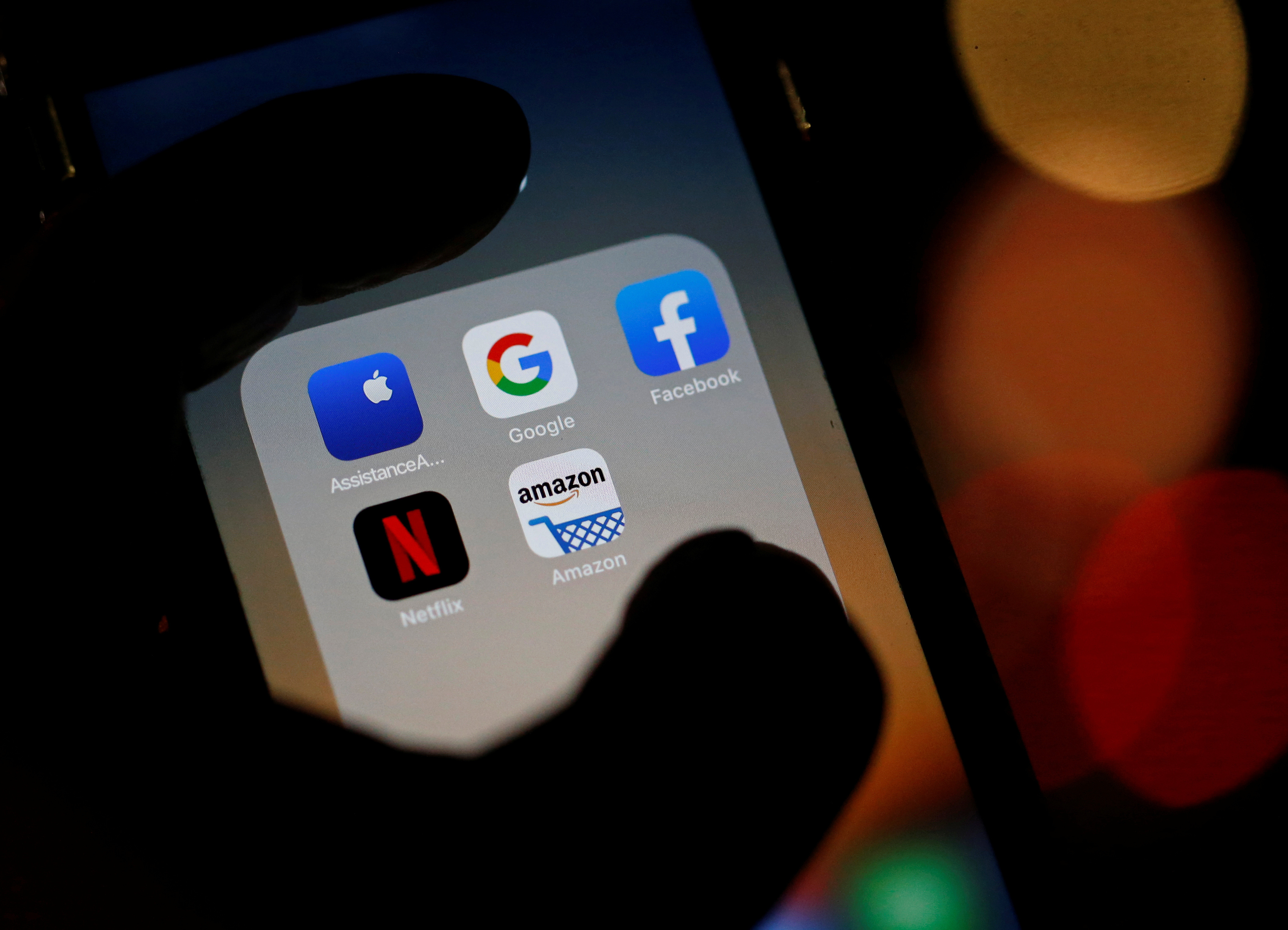 The logos of mobile apps, Google, Amazon, Facebook, Apple and Netflix, are displayed on a screen in this illustration picture taken December 3, 2019. REUTERS/Regis Duvignau - RC2VND9O022Y