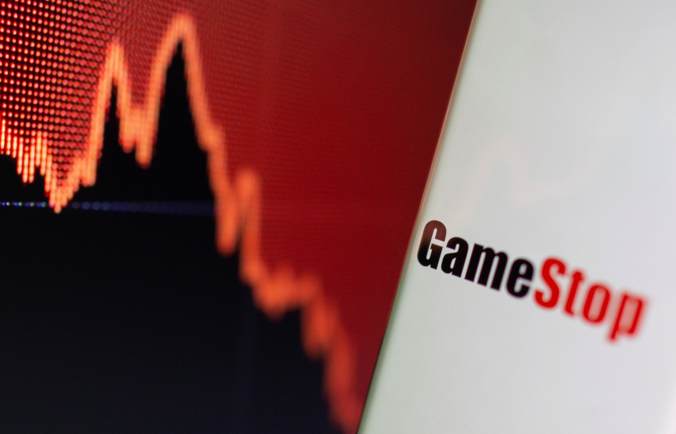 GameStop logo is seen near displayed stock graph in this illustration taken February 2, 2021.