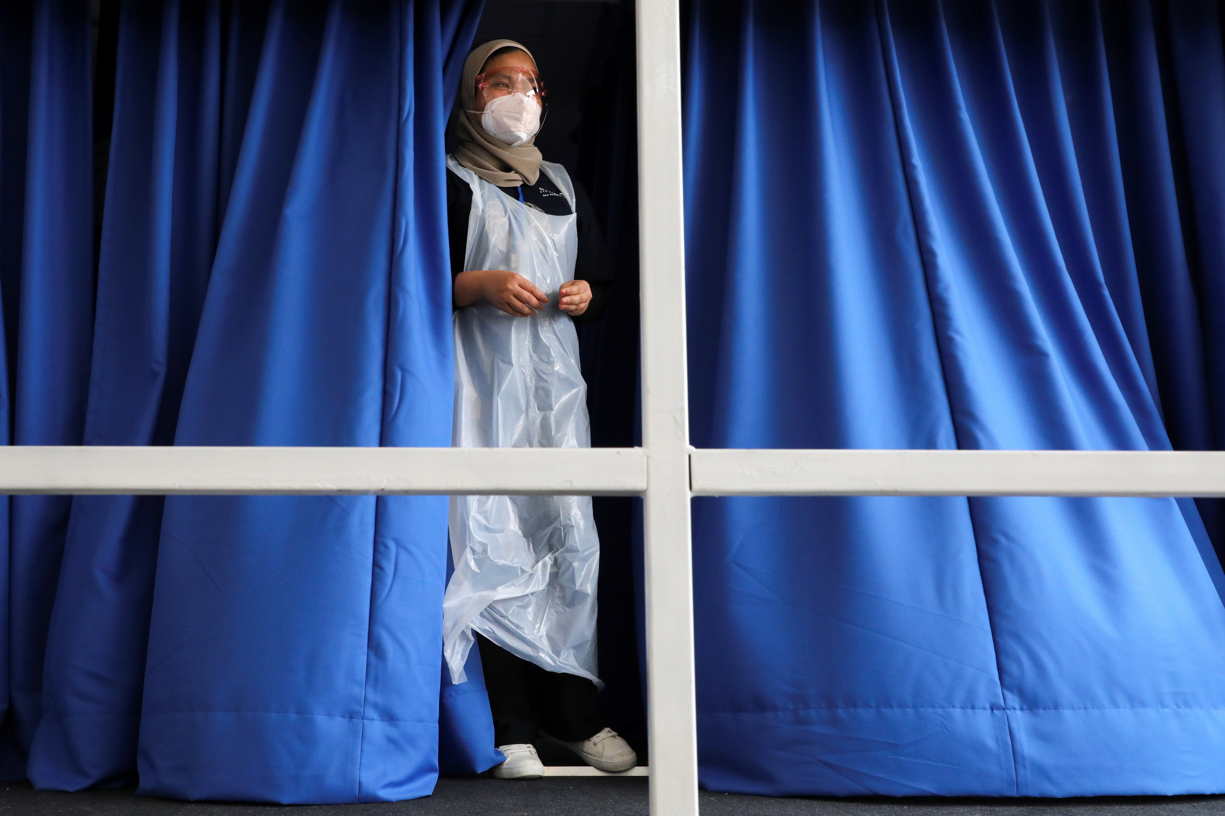 A medical worker looks out from a coronavirus disease (COVID-19) vaccination truck in Kuala Lumpur, Malaysia June 8, 2021.