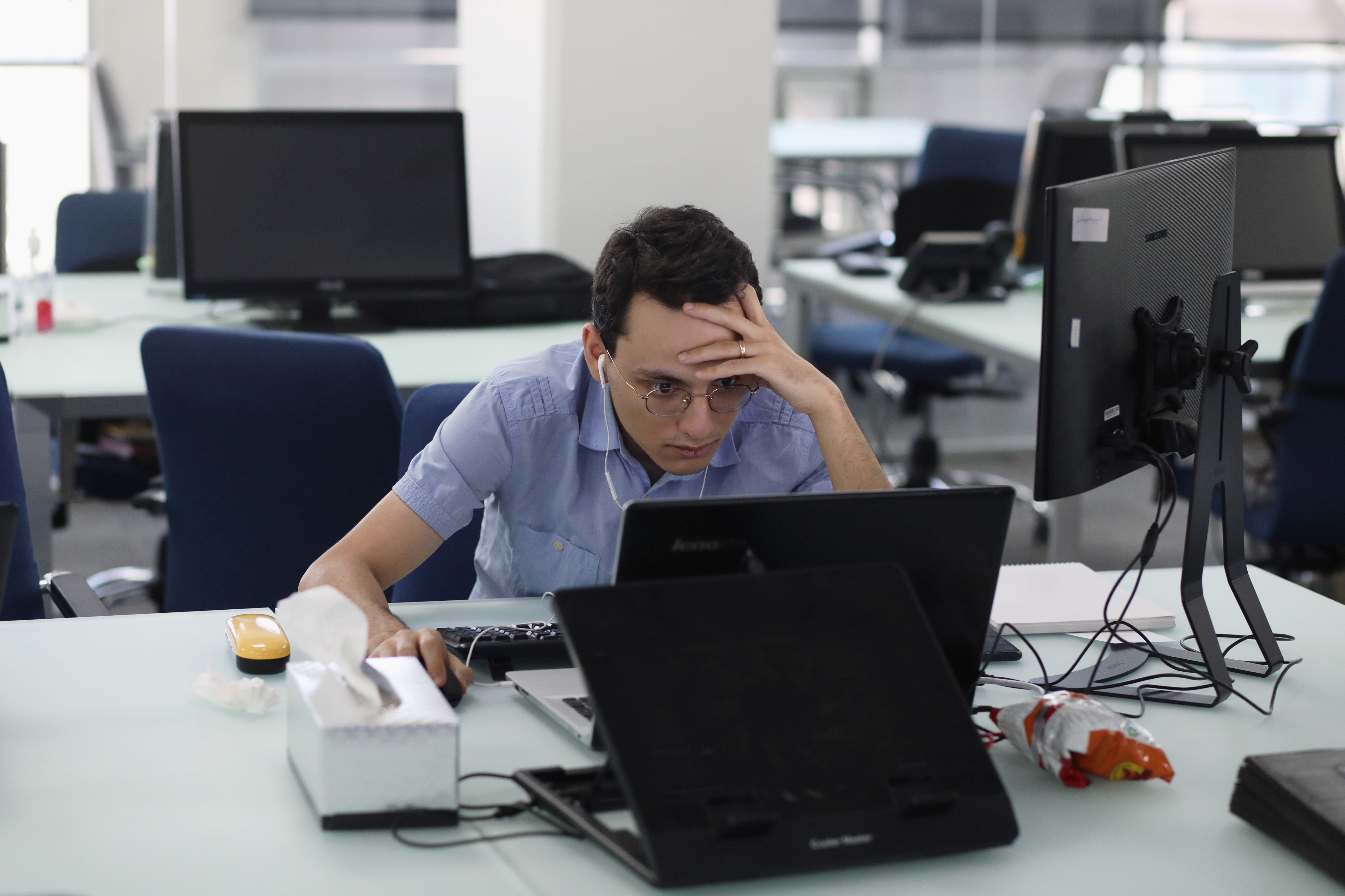 An employee of a stock brokerage firm monitors stock prices on his computer, following the outbreak of the coronavirus disease (COVID-19), at a brokerage house in Tehran, Iran, May 12, 2020. Picture taken May 12, 2020. WANA (West Asia News Agency)/Ali Khara via REUTERS ATTENTION EDITORS - THIS PICTURE WAS PROVIDED BY A THIRD PARTY - RC2HOG9KDBJ5