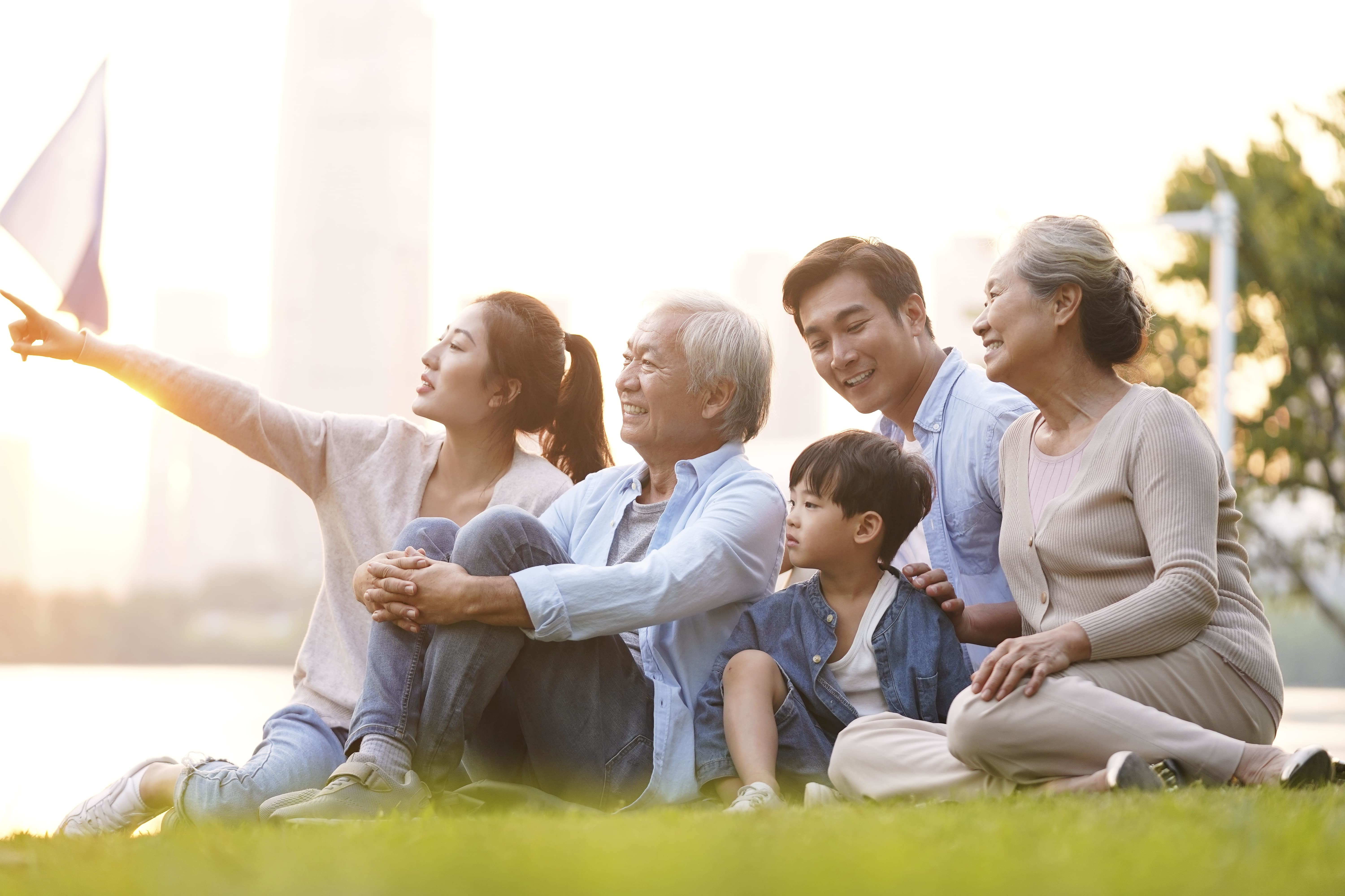 multigeneration asian family looking happy and healthy