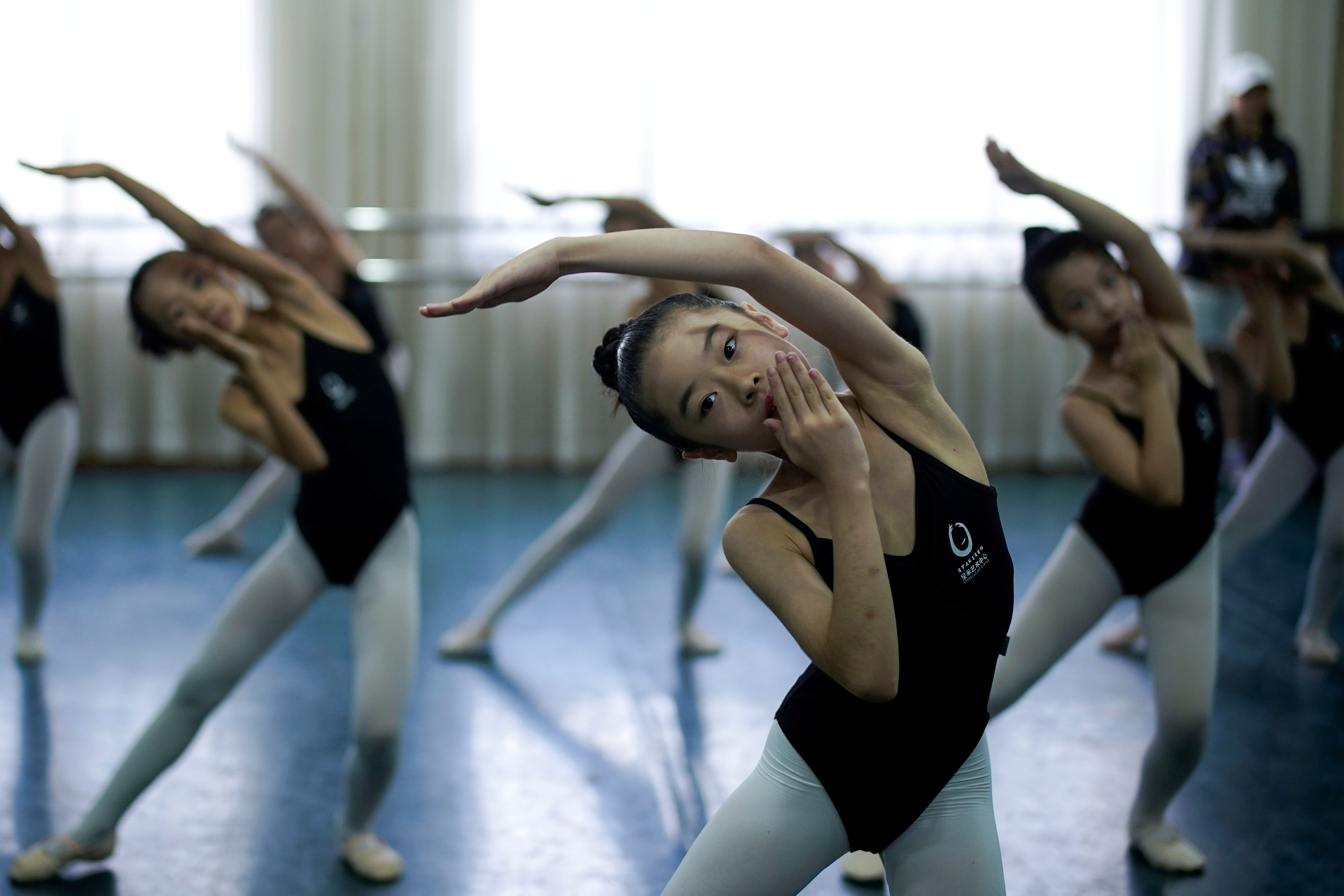 Students dance at Changchun Street Primary School of Wuhan during a government-organized media tour following the coronavirus disease (COVID-19) outbreak, in Wuhan, Hubei province, China, September 4, 2020. REUTERS/Aly Song - RC2FRI938279