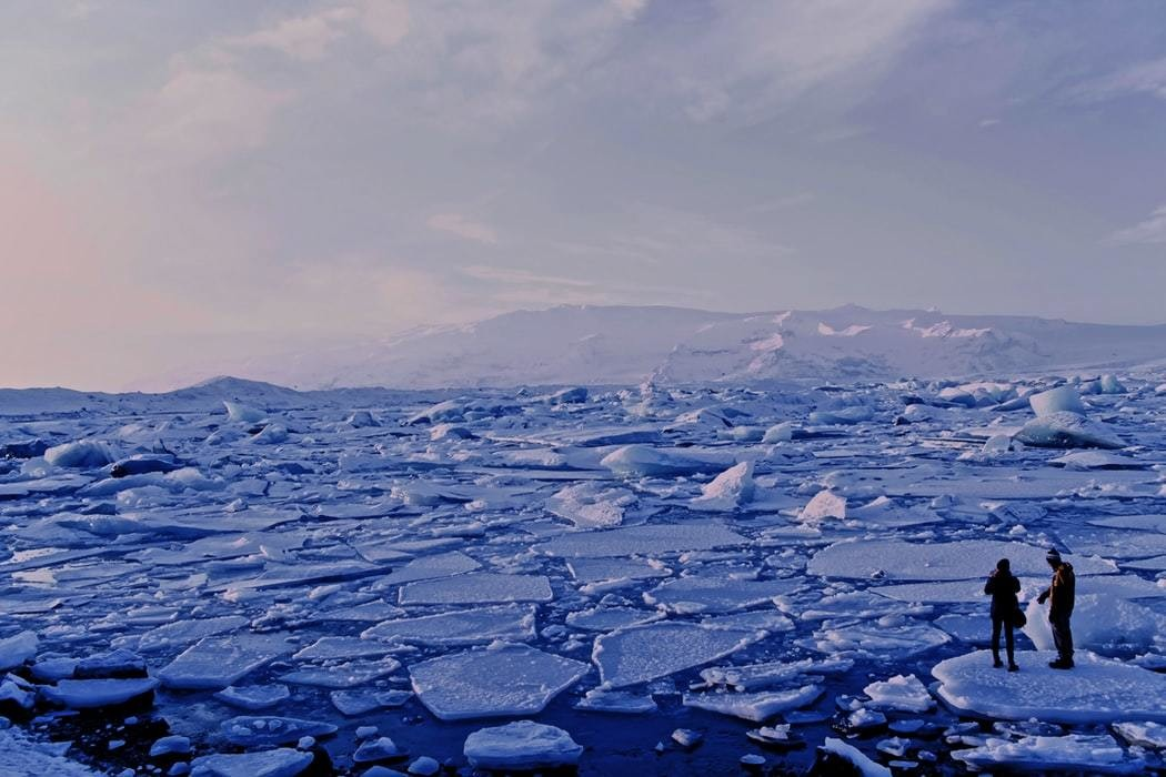 image of people watching breaking ice sheets