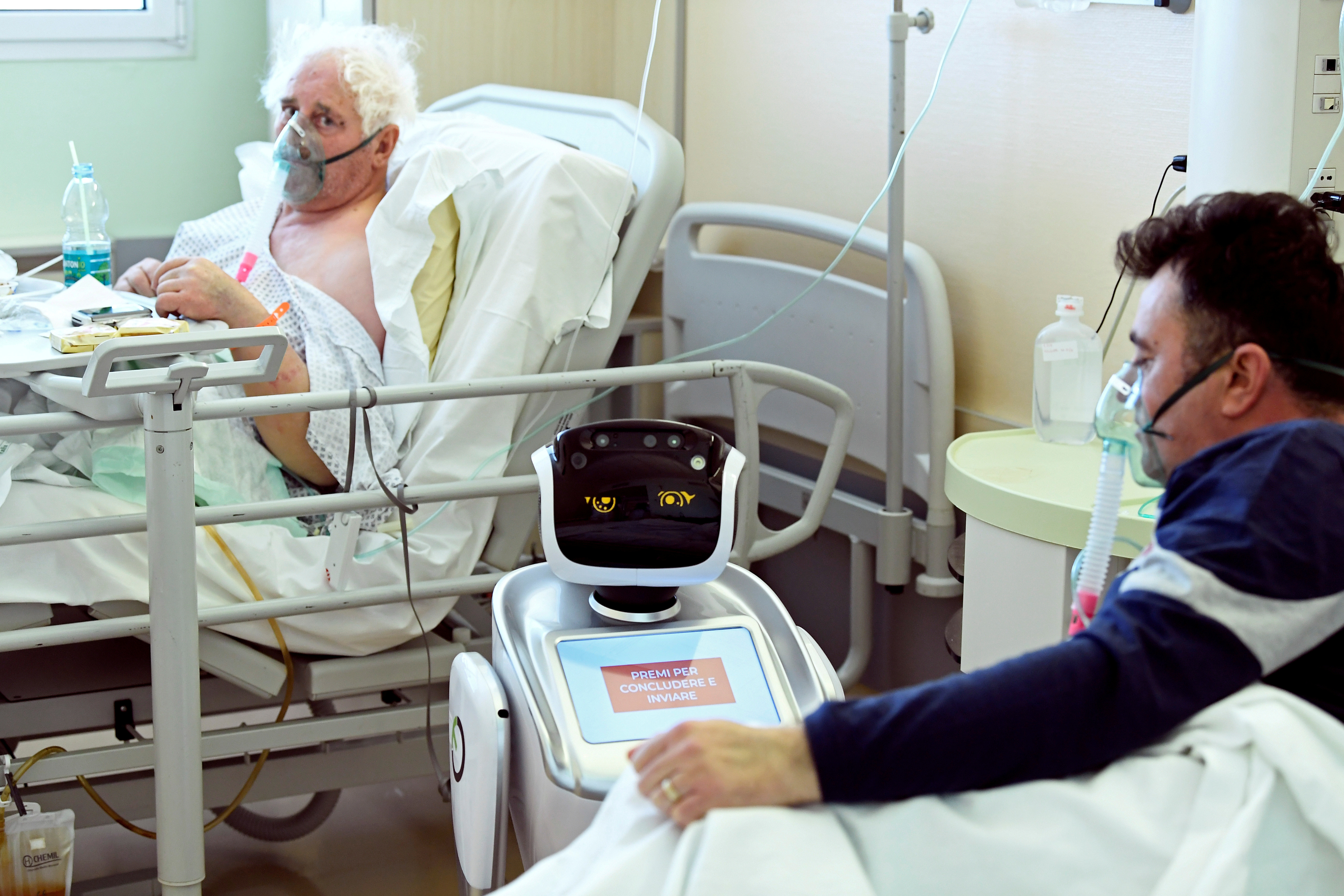A robot helping medical teams treat patients suffering from the coronavirus disease (COVID-19) is pictured at a patients' roo