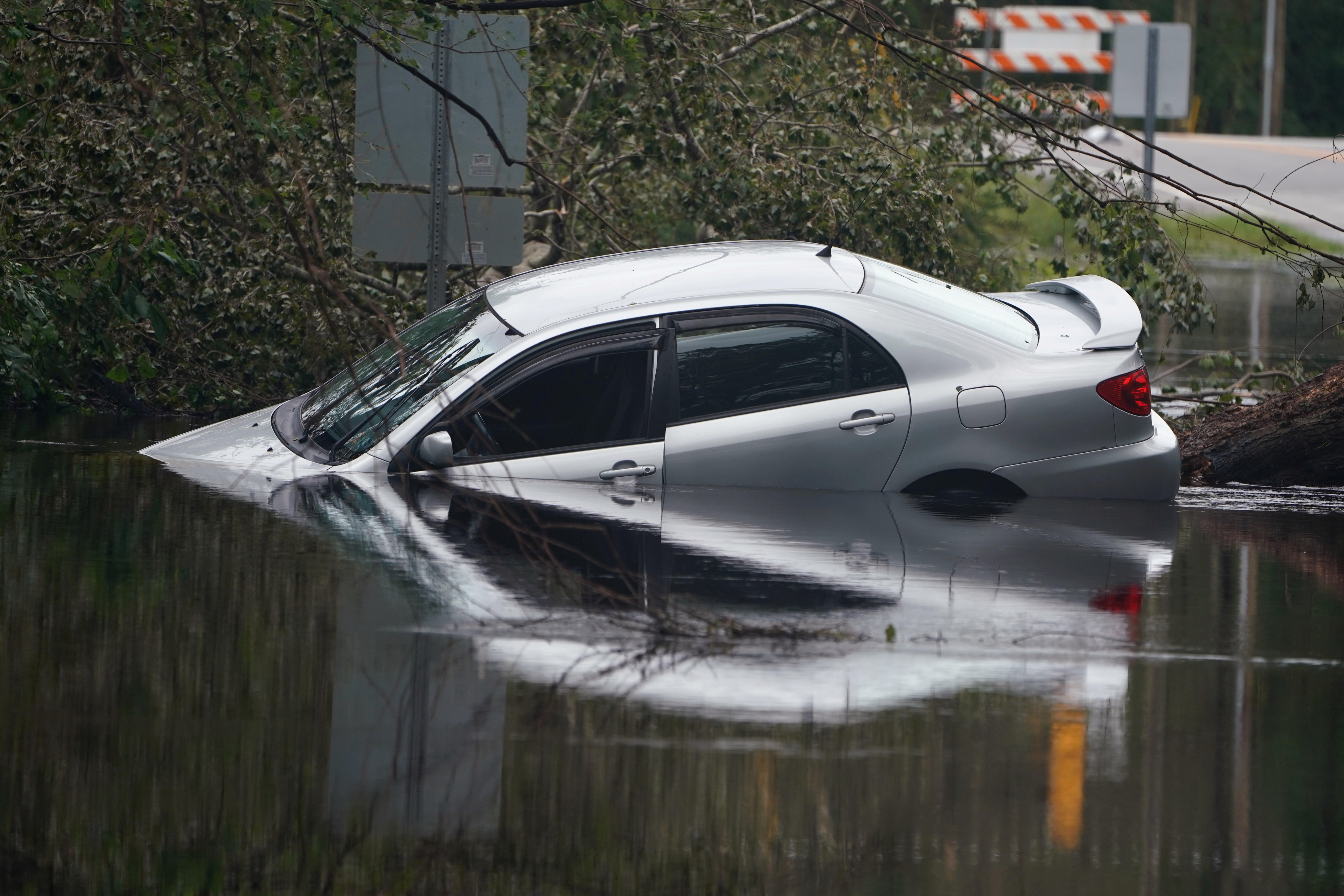 A partially submerged car is pictured on a flooded street after Hurricane Florence struck Piney Green, North Carolina, U.S., September 16, 2018.