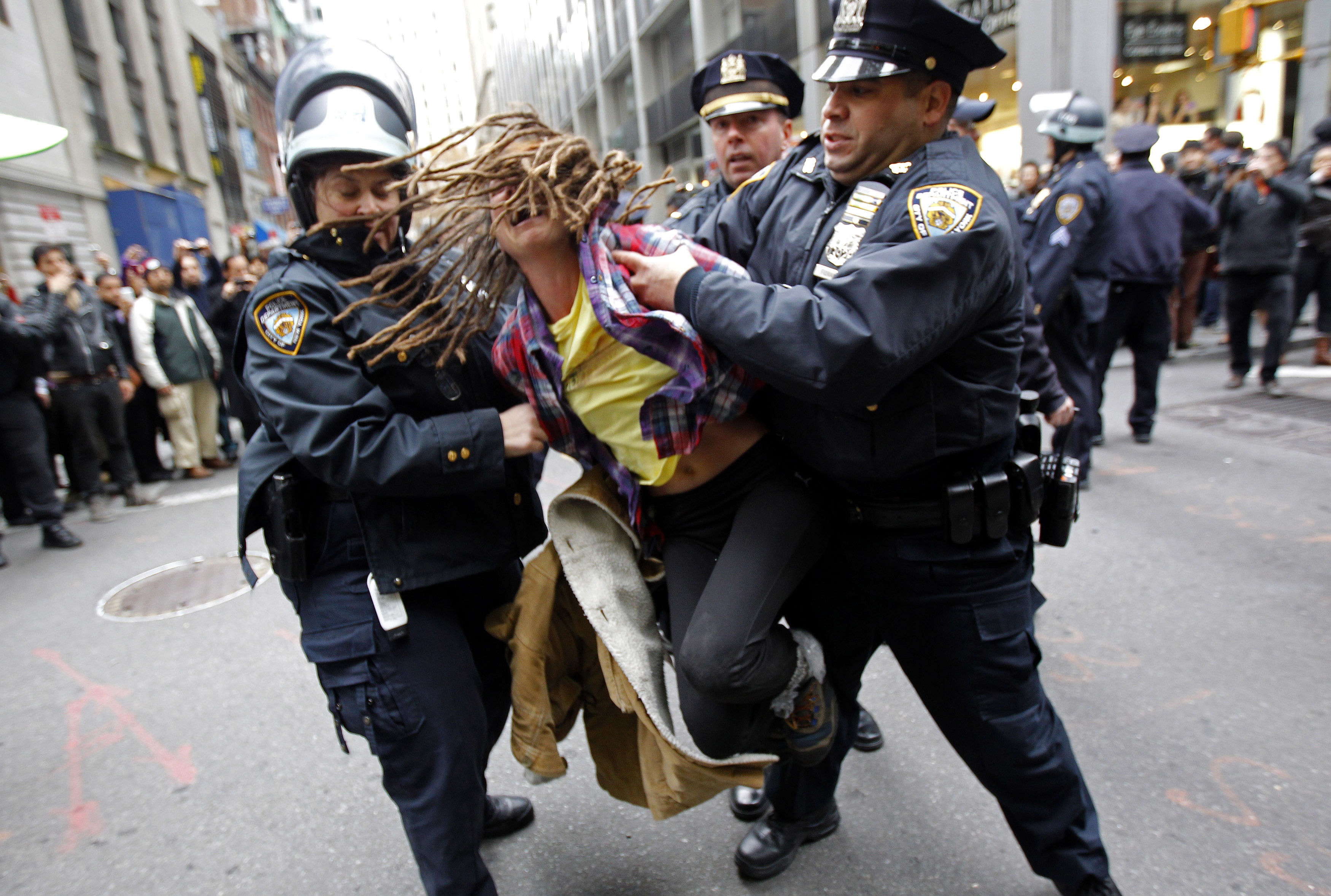 "An Occupy Wall Street demonstrator is arrested by New York City Police during what protest organizers called a ""Day of Action"" in New York November 17, 2011. Hundreds of Occupy Wall Street protesters marched through New York's financial district toward the stock exchange on Thursday to protest economic inequality at the heart of American capitalism. REUTERS/Mike Segar (UNITED STATES - Tags: BUSINESS CIVIL UNREST TPX IMAGES OF THE DAY) - GM1E7BH1RU601"