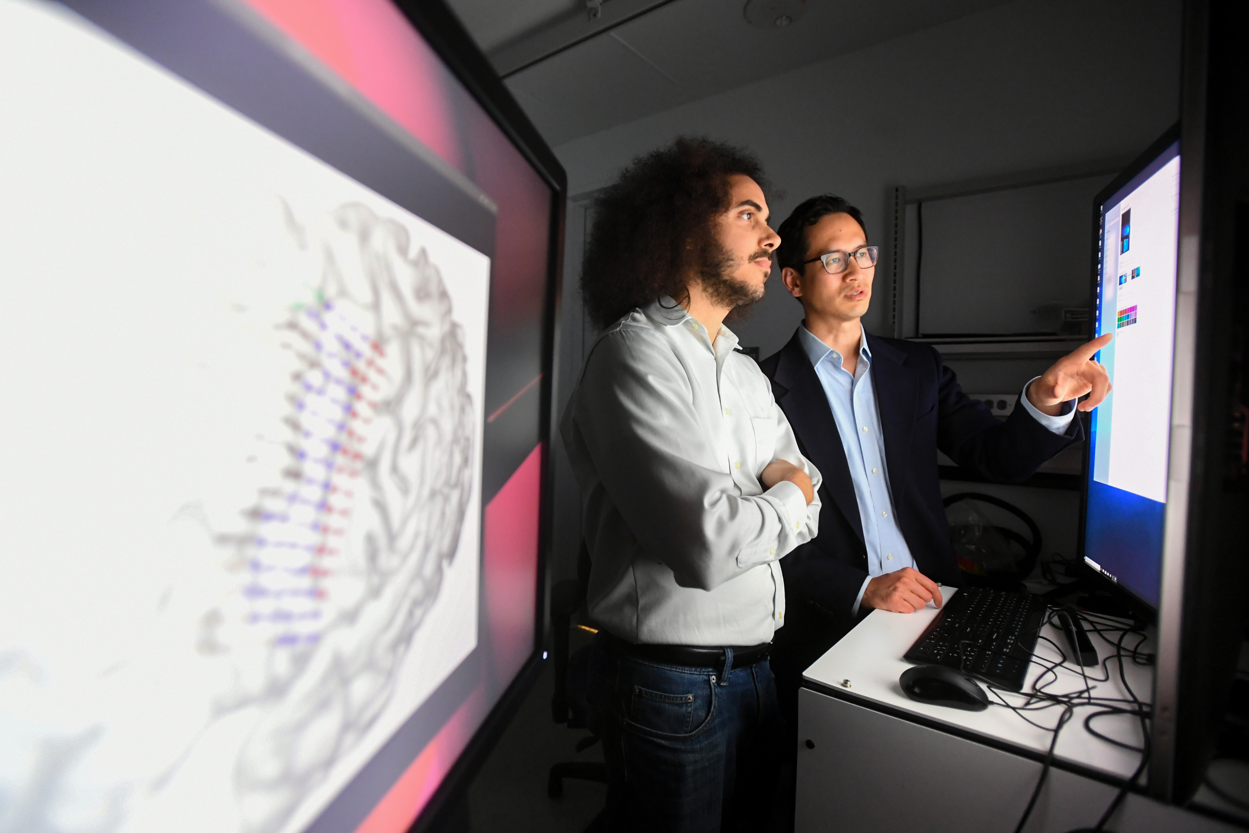 Researchers work in Dr. Eddie Chang's lab at UCSF's Mission Bay campus on Friday, June 7, 2019, in San Francisco. Pictured are postdoctoral scholar Pengfei Sun, PhD, research scientist Joseph Makin, PhD, and postdoctoral scholar David Moses, PhD. (Photo by Noah Berger)CONSENT FORMS OBTAINED