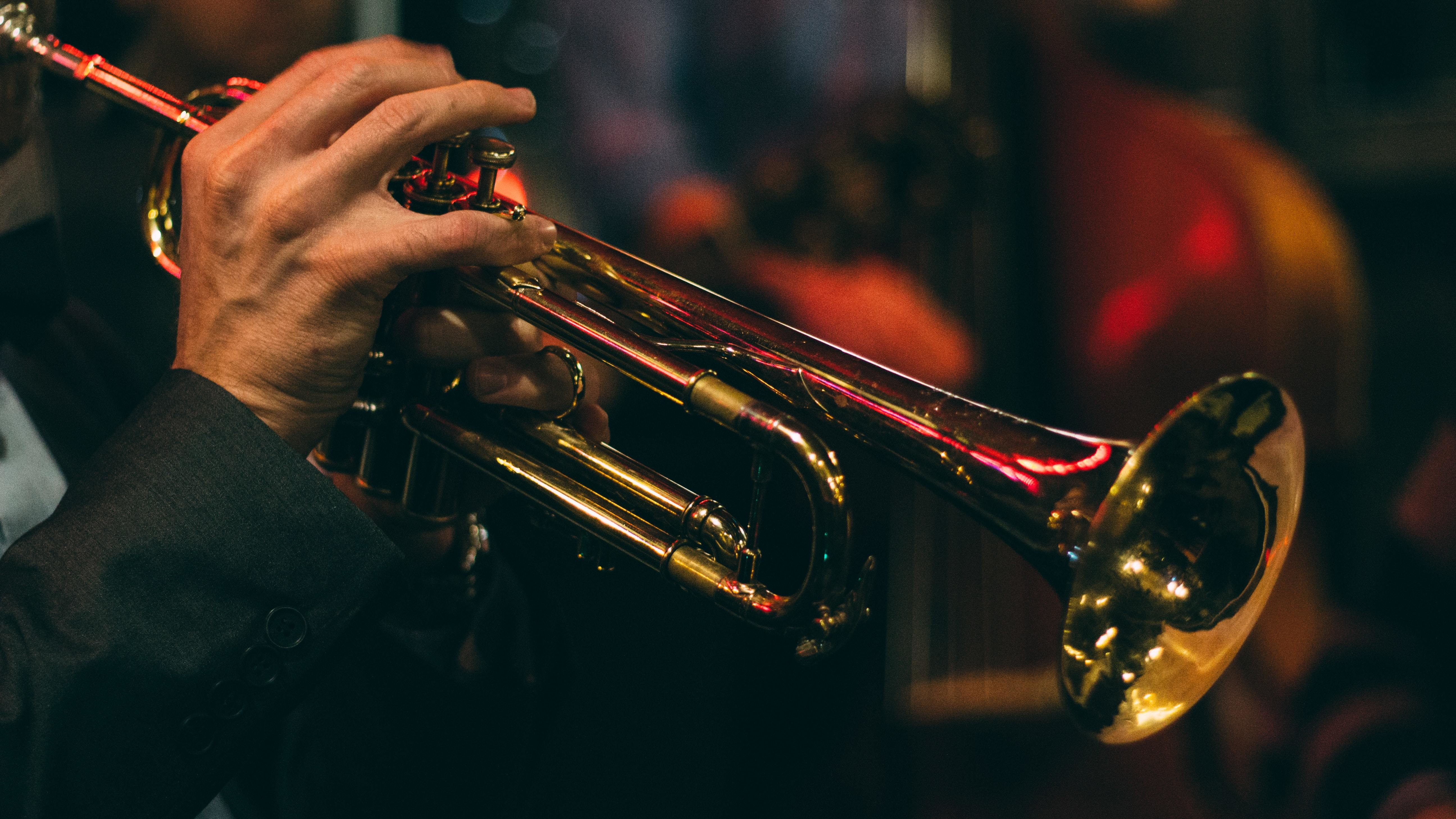 this is someone playing jazz on a trumpet. Jazz music is something that would be challenging for artificial intelligence to replicate, due to its often spontaneous nature