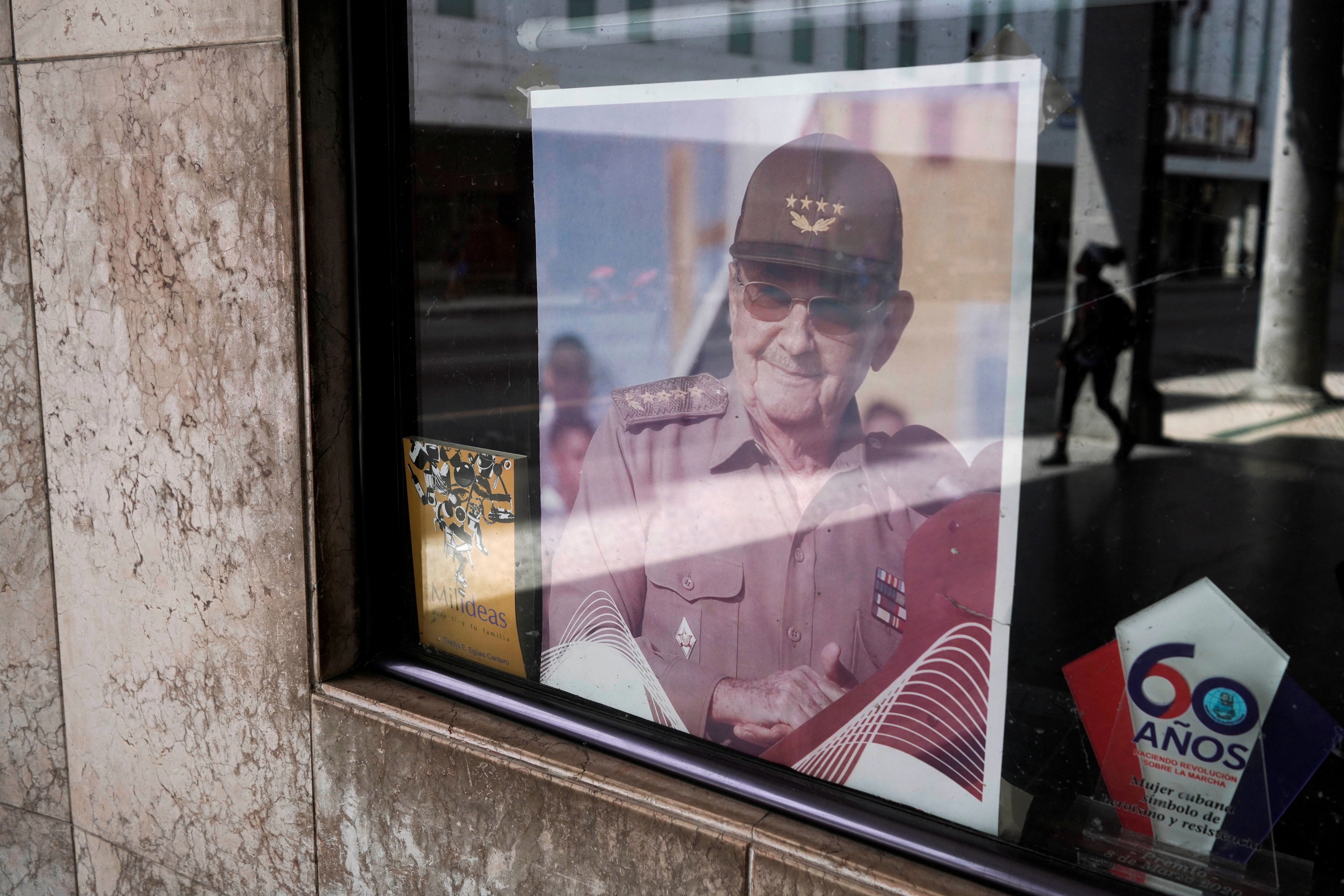 A picture of former Cuban President Raul Castro is displayed in the window of a state building in Havana, Cuba, April 11, 2021. Picture taken April 11, 2021. REUTERS/Alexandre Meneghini - RC26VM9QWV9Y