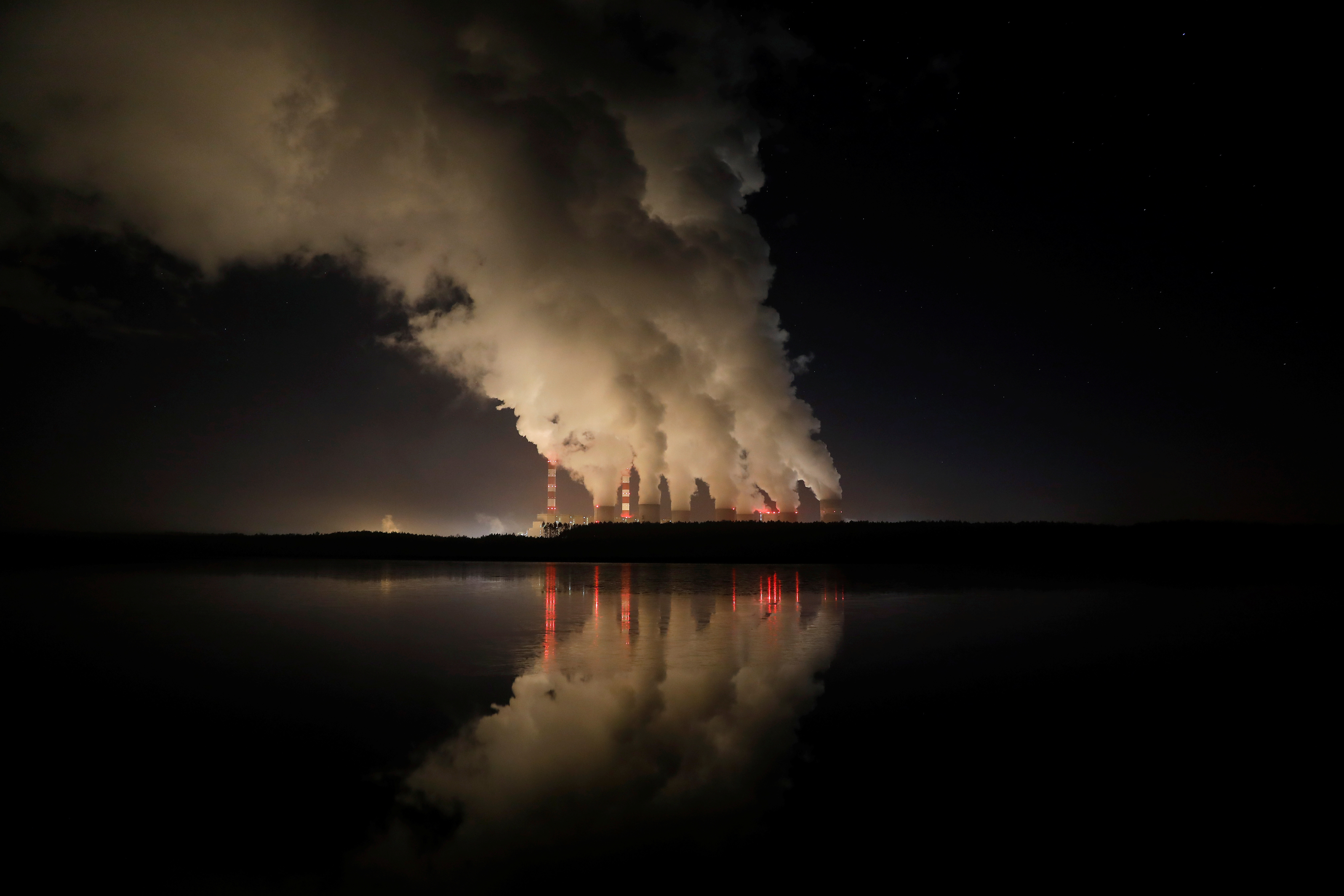 Smoke and steam billows from Belchatow Power Station, Europe's largest coal-fired power plant operated by PGE Group, at night near Belchatow, Poland December 5, 2018. Picture taken December 5, 2018