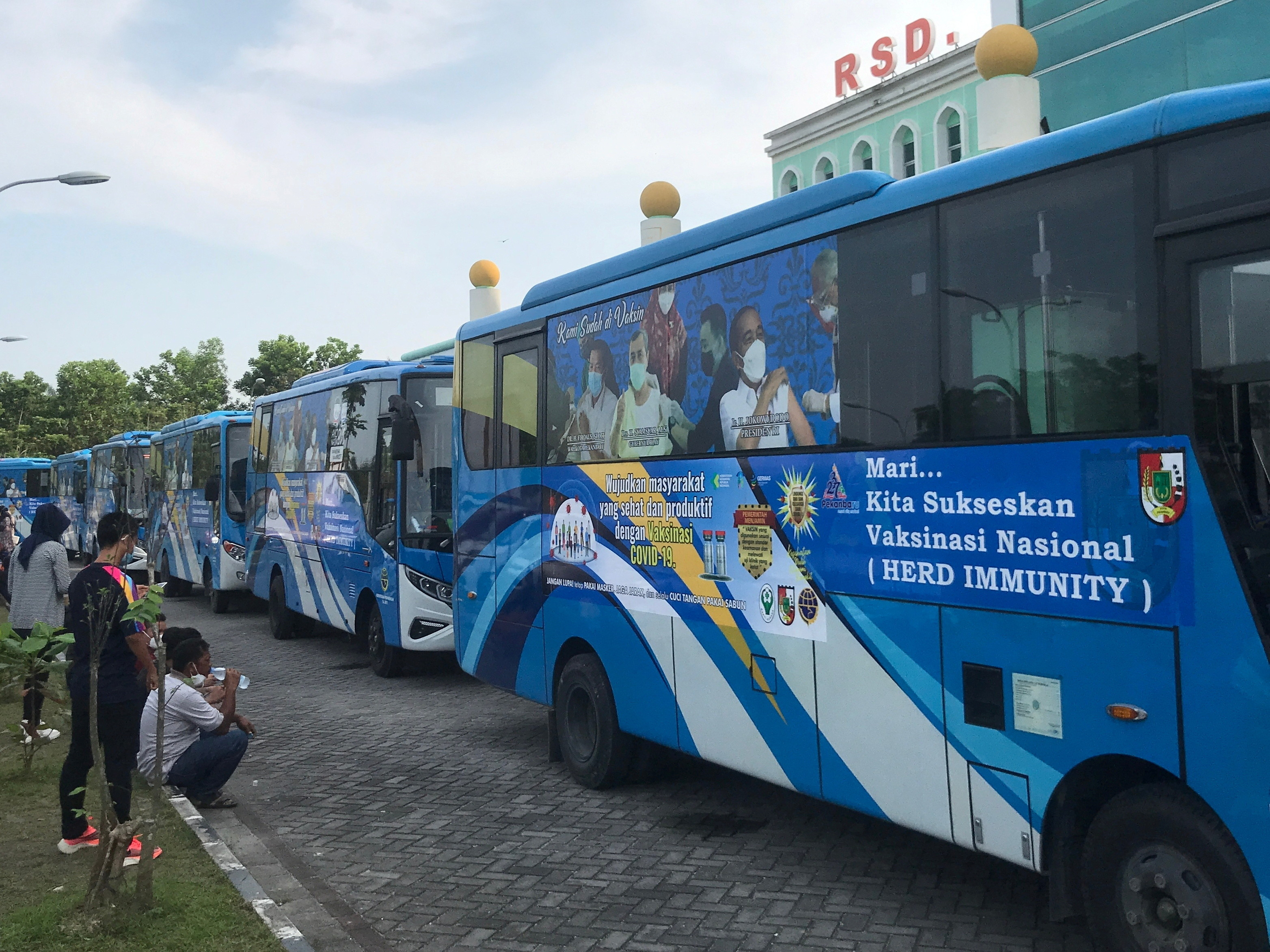 Public buses, used as a coronavirus disease (COVID-19) vaccination venue, are seen parked outside the Madani hospital in Pekanbaru, Riau province, Indonesia, June 8, 2021. Picture taken June 8, 2021. REUTERS/Stringer - RC21WN9VOOA3