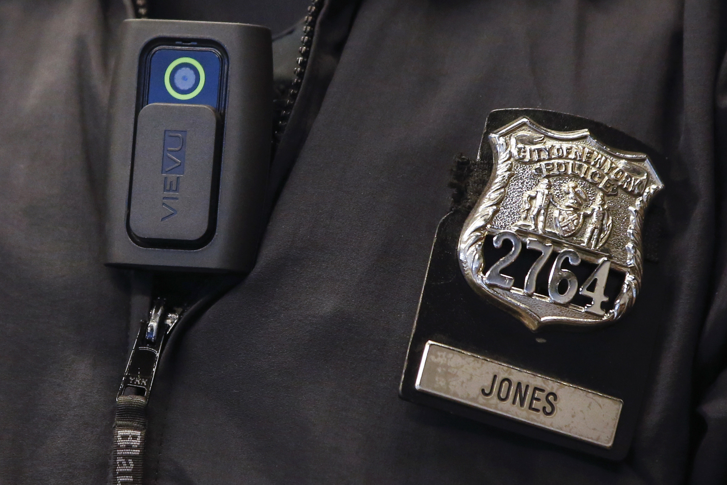 A police body camera is seen on an officer during a news conference on the pilot program involving 60 NYPD officers dubbed 'Big Brother' at the NYPD police academy in the Queens borough of New York, December 3, 2014.  REUTERS/Shannon Stapleton (UNITED STATES - Tags: CIVIL UNREST CRIME LAW SCIENCE TECHNOLOGY) - GM1EAC4054101