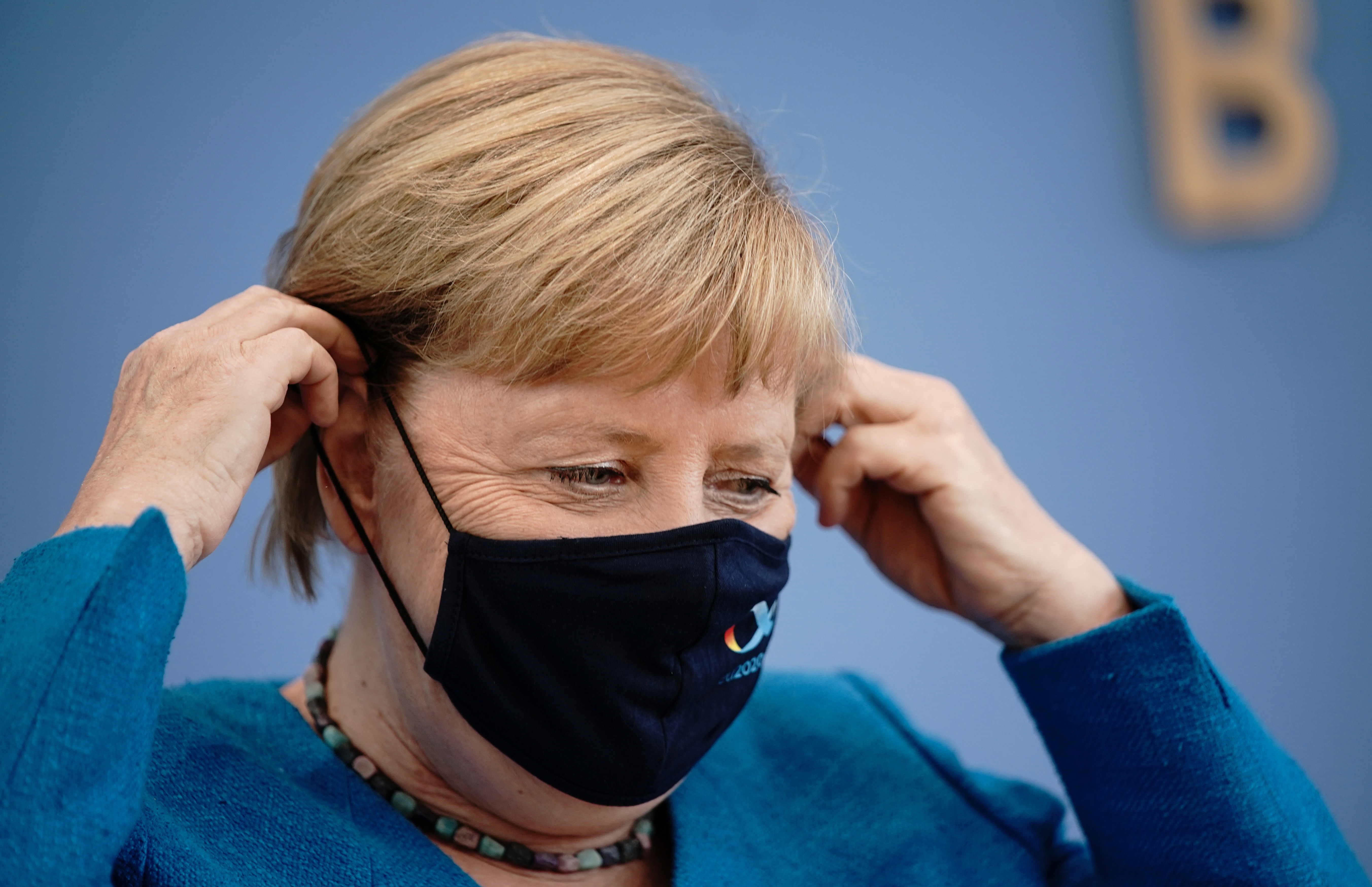 German Chancellor Angela Merkel wears a mask as she leaves her annual summer news conference during the outbreak of the coronavirus disease (COVID-19) in Berlin, Germany, August 28, 2020.      Michael Kappeler/Pool via REUTERS - RC2ZMI9CHMUB