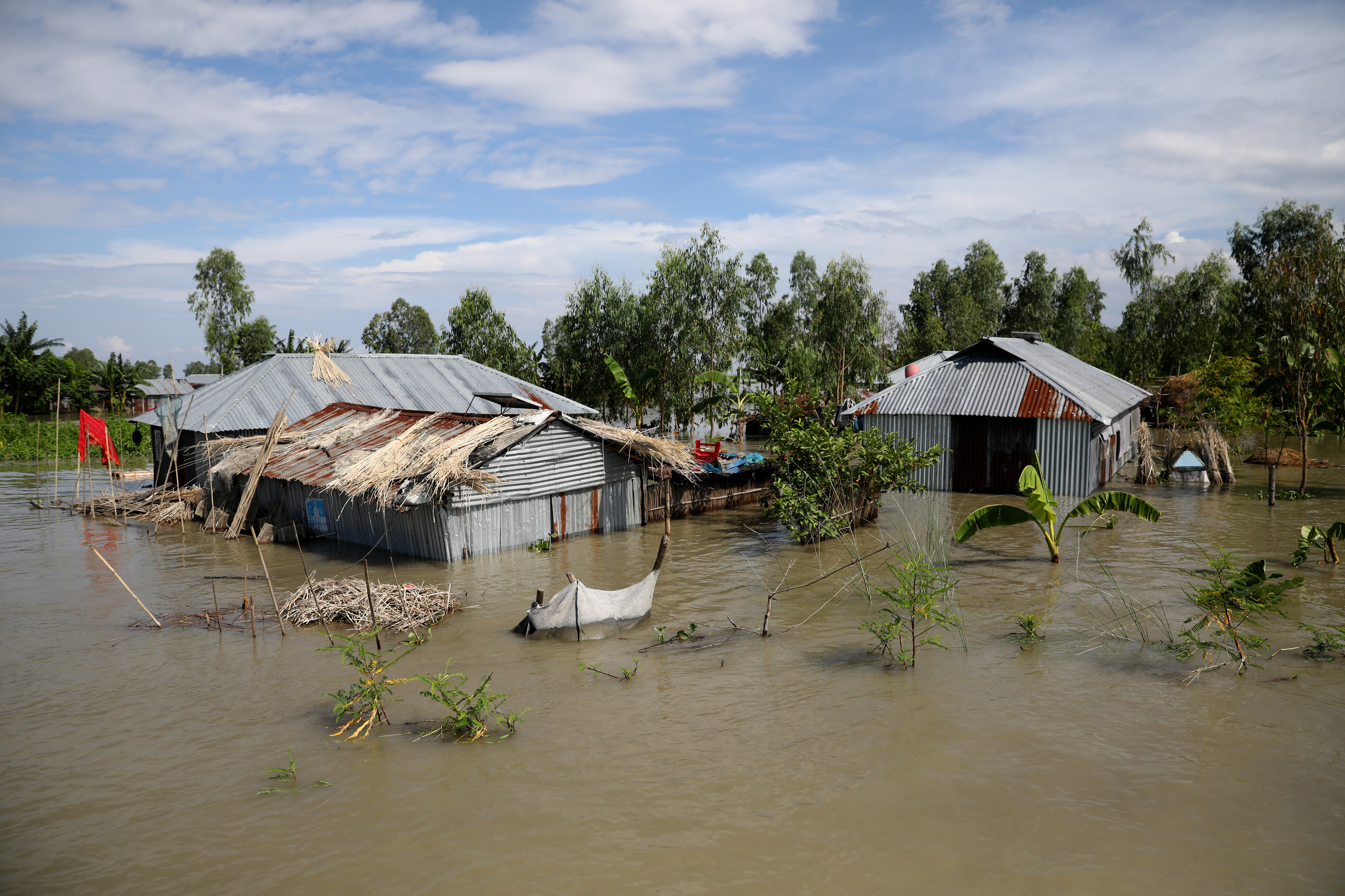Houses are seen flooded, in Bogura, Bangladesh, July 17, 2020. REUTERS/Mohammad Ponir Hossain - RC25VH9HKV9V