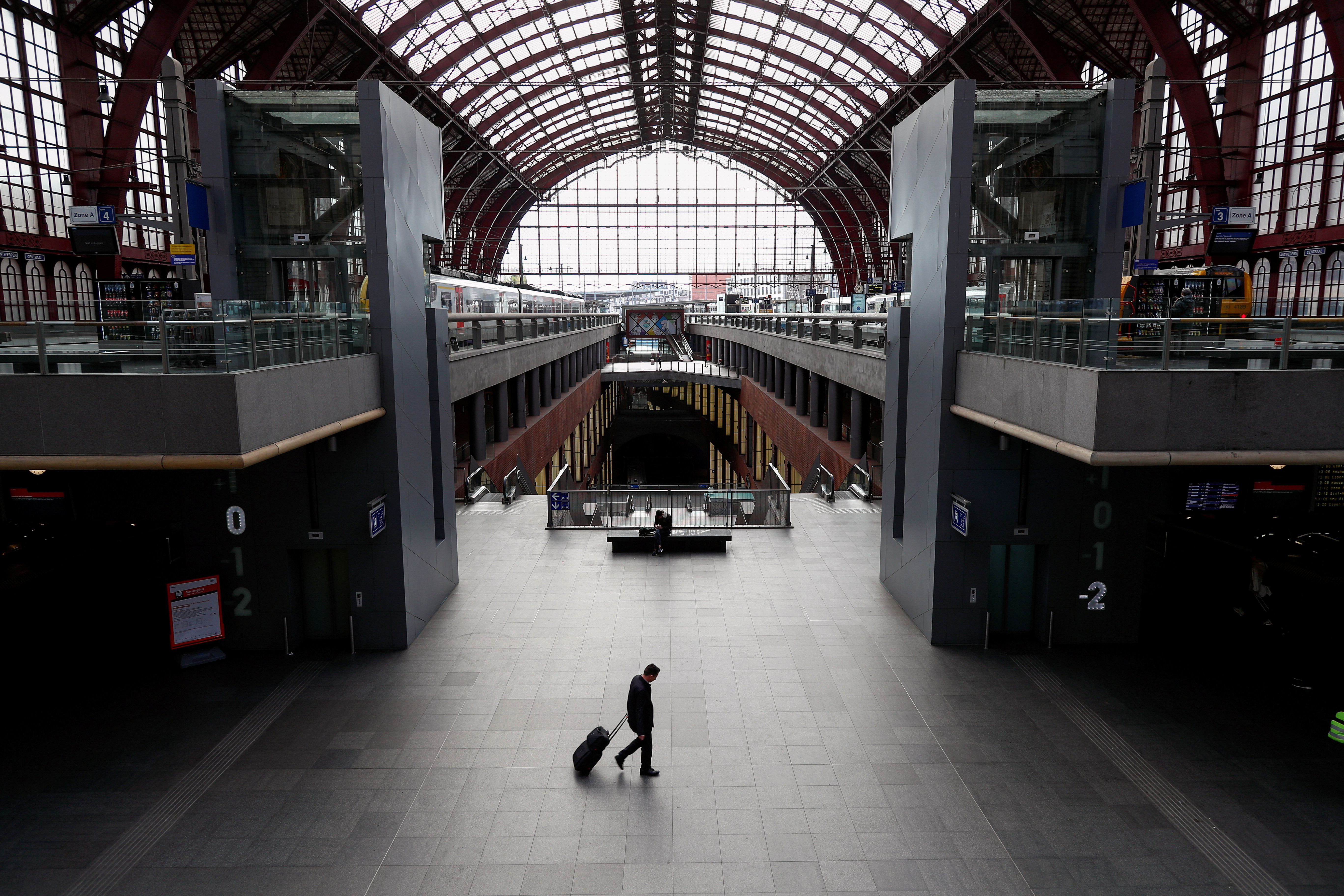 A man walks with his luggage through the almost empty railway station, after Belgium imposed a lockdown to slow down the spread of the coronavirus disease (COVID-19), in Antwerp, Belgium March 18, 2020.  REUTERS/Francois Lenoir     TPX IMAGES OF THE DAY - RC2CMF9IZEPF