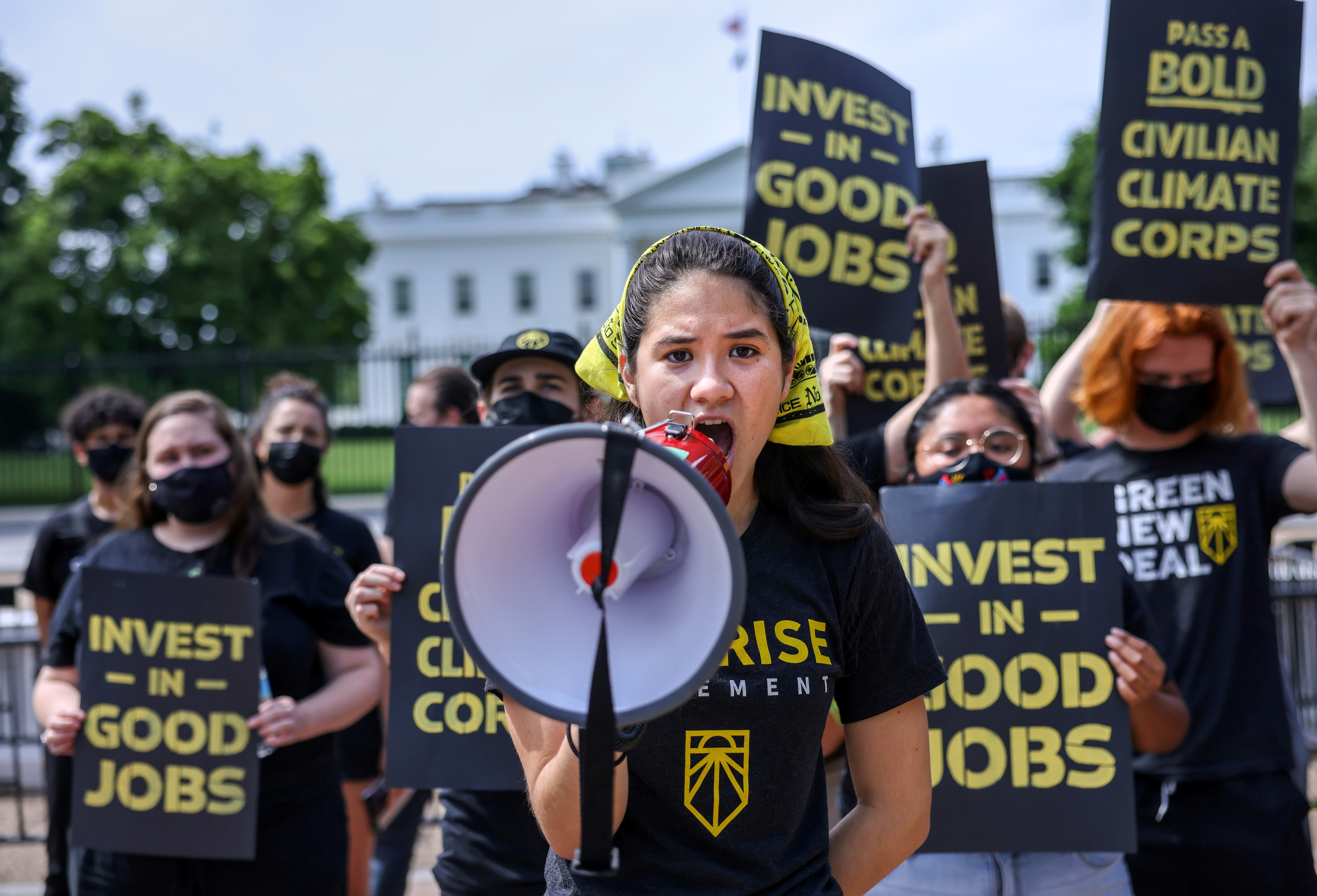 Audrey Lin chants during a demonstration by the Sunrise Movement outside the White House demanding action on climate change and green jobs in Washington, U.S., June 4, 2021.