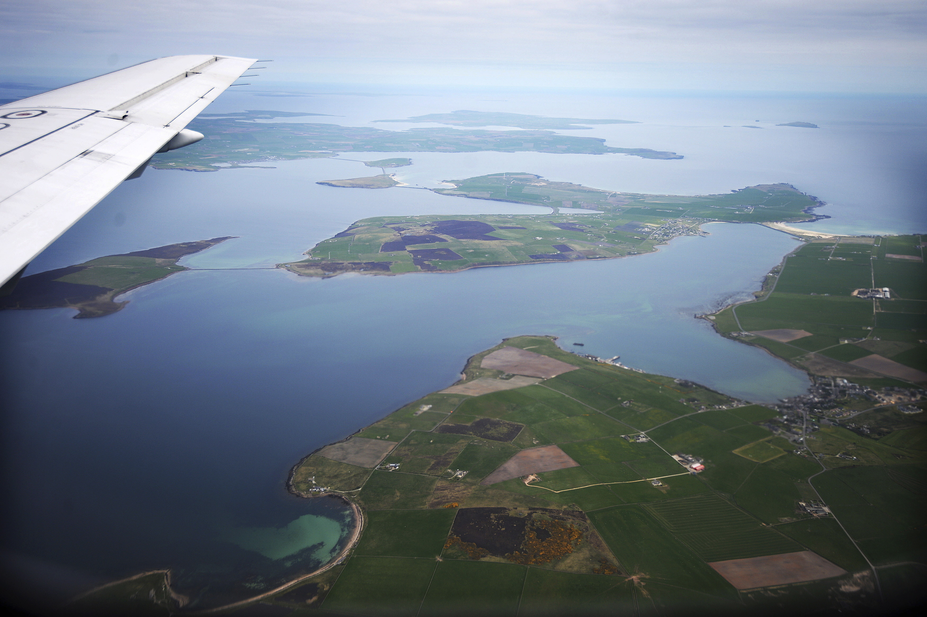 An aerial view of the Orkney Islands, Scotland May 3, 2014. During both World Wars, Scapa Flow was an important British naval base, and the site of significant loss of life. Following the end of World War One, 74 German warships were interned there, and on June 21, 1919 most were deliberately sunk, or scuttled, at the orders of German Rear Admiral Ludwig Von Reuter, who mistakenly thought that the Armistice had broken down and wanted to prevent the British from using the ships. Now Scapa Flow is a popular site for divers, who explore the few wrecks that still remain at the bottom. The year 2014 marks the 100th anniversary of the start of the First World War. Picture taken May 3, 2014. REUTERS/Nigel Roddis (BRITAIN - Tags: CONFLICT ANNIVERSARY ENVIRONMENT SOCIETY MARITIME) ATTENTION EDITORS: PICTURE 01 OF 28 FOR PACKAGE 'WWI - EXPLORING SUNKEN WARSHIPS'TO FIND ALL IMAGES SEARCH 'SCAPA FLOW' - GM1EA6J0S8B01