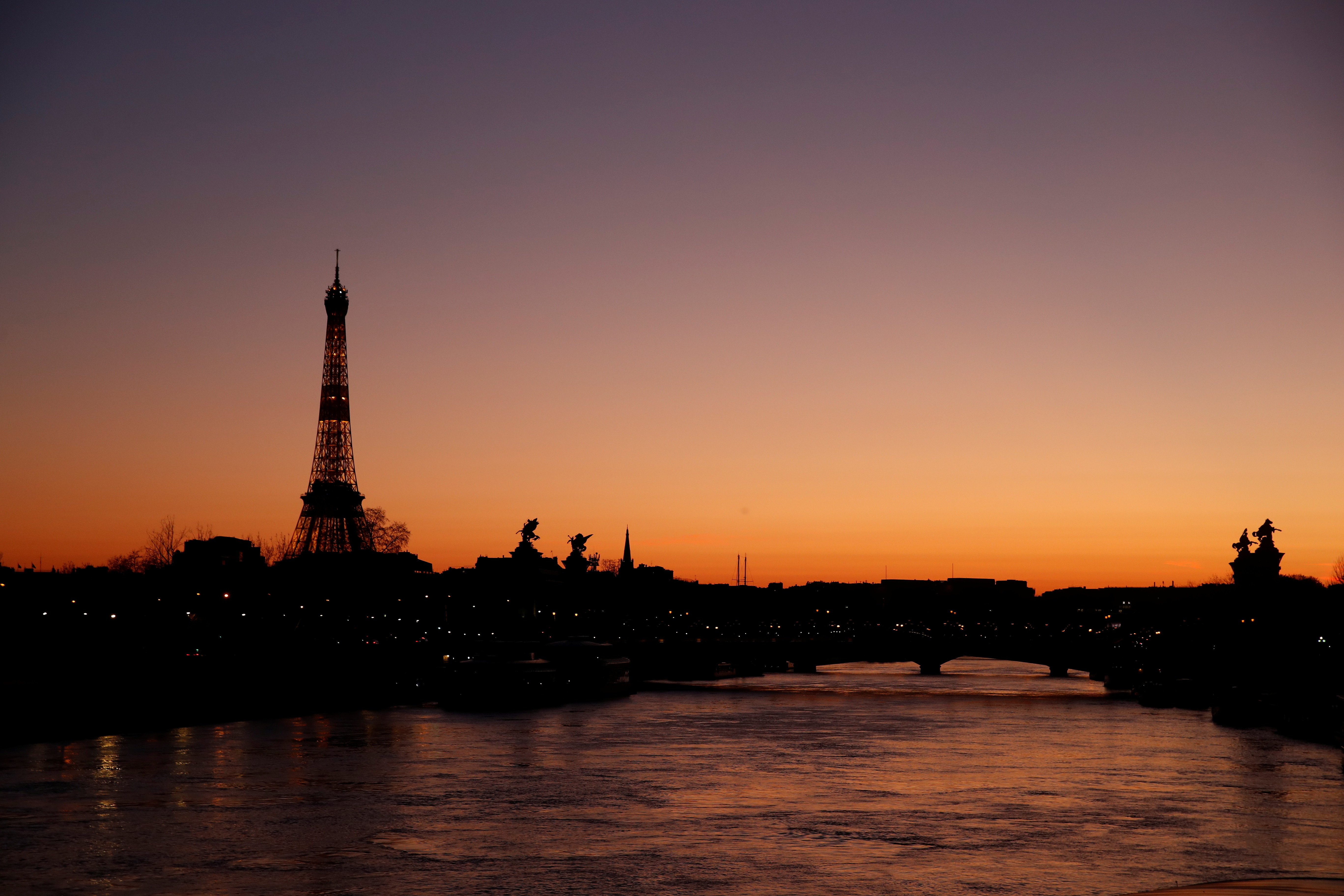 The Eiffel Tower is seen at sunset in Paris as a lockdown is imposed to slow the rate of the coronavirus disease (COVID-19) spread in France, March 24, 2020. REUTERS/Gonzalo Fuentes - RC2JQF99AL09
