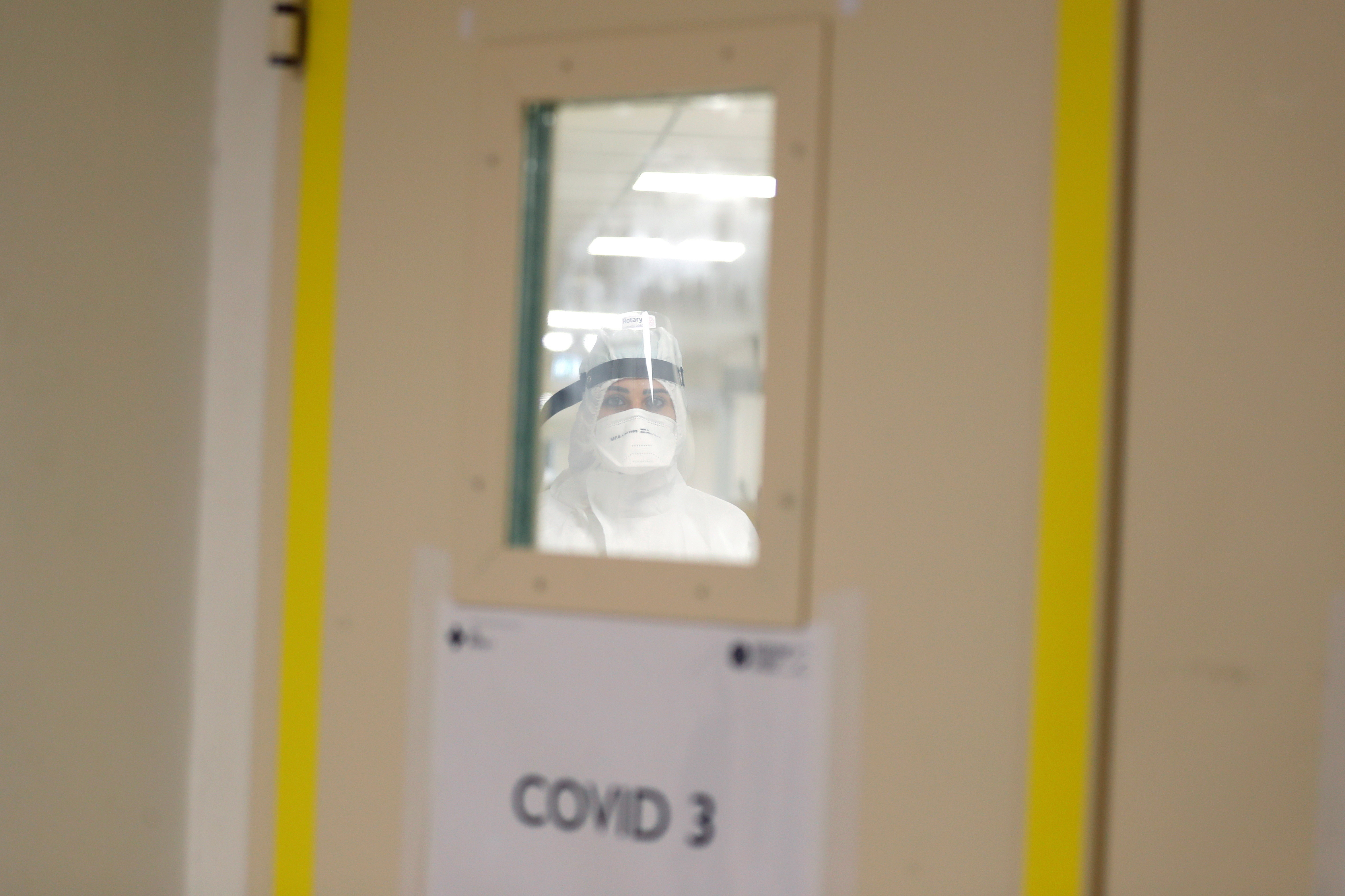 A medical worker is seen inside the pre-intensive care unit for coronavirus disease (COVID-19) at the San Filippo Neri hospital in Rome, Italy, October 29, 2020. REUTERS/Yara Nardi - RC2DSJ9CZOXB