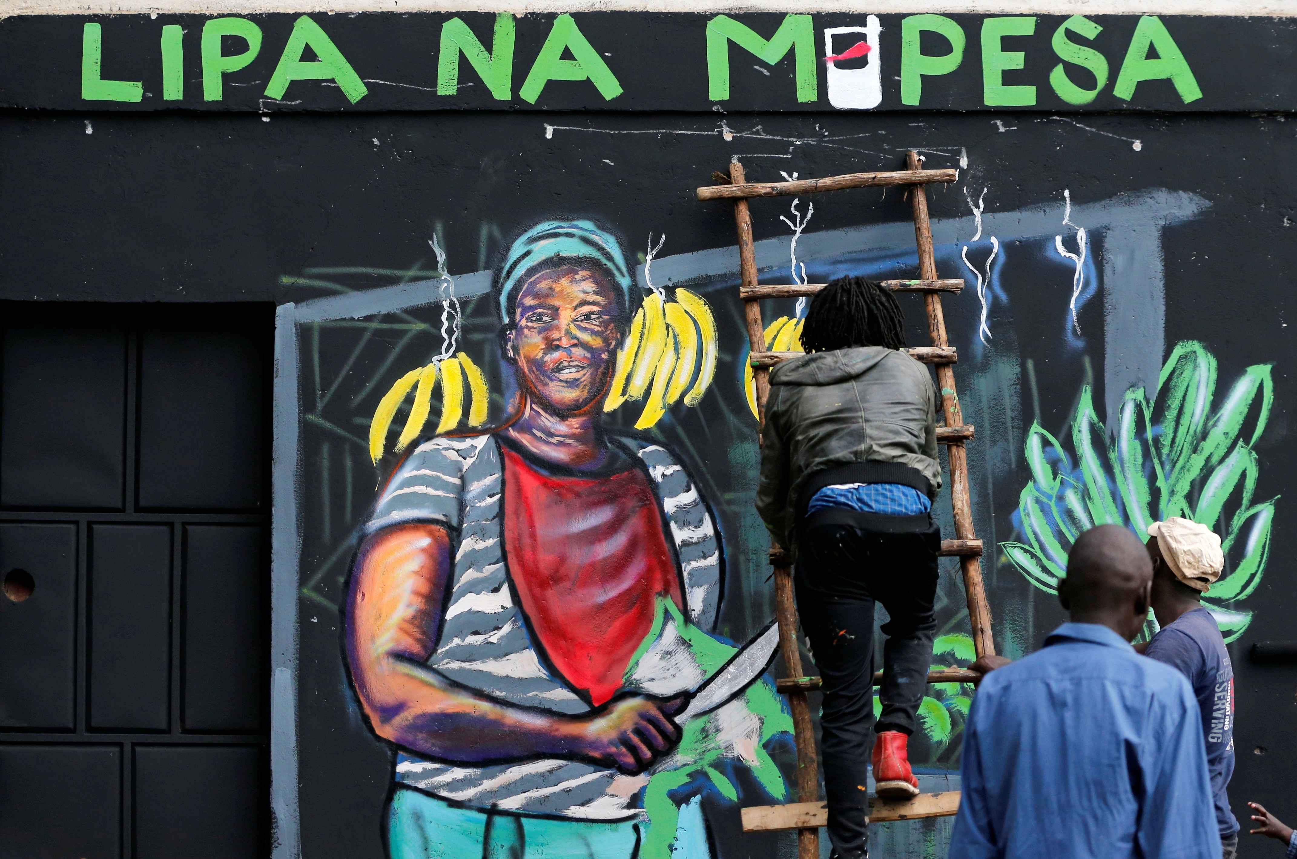 An artist works on a mural advocating for retail M-Pesa mobile phone cashless payments as a measure against the spread of the coronavirus disease (COVID-19) in Nairobi, Kenya April 19, 2020. Picture taken April 19, 2020. REUTERS/Thomas Mukoya - RC288G92R457