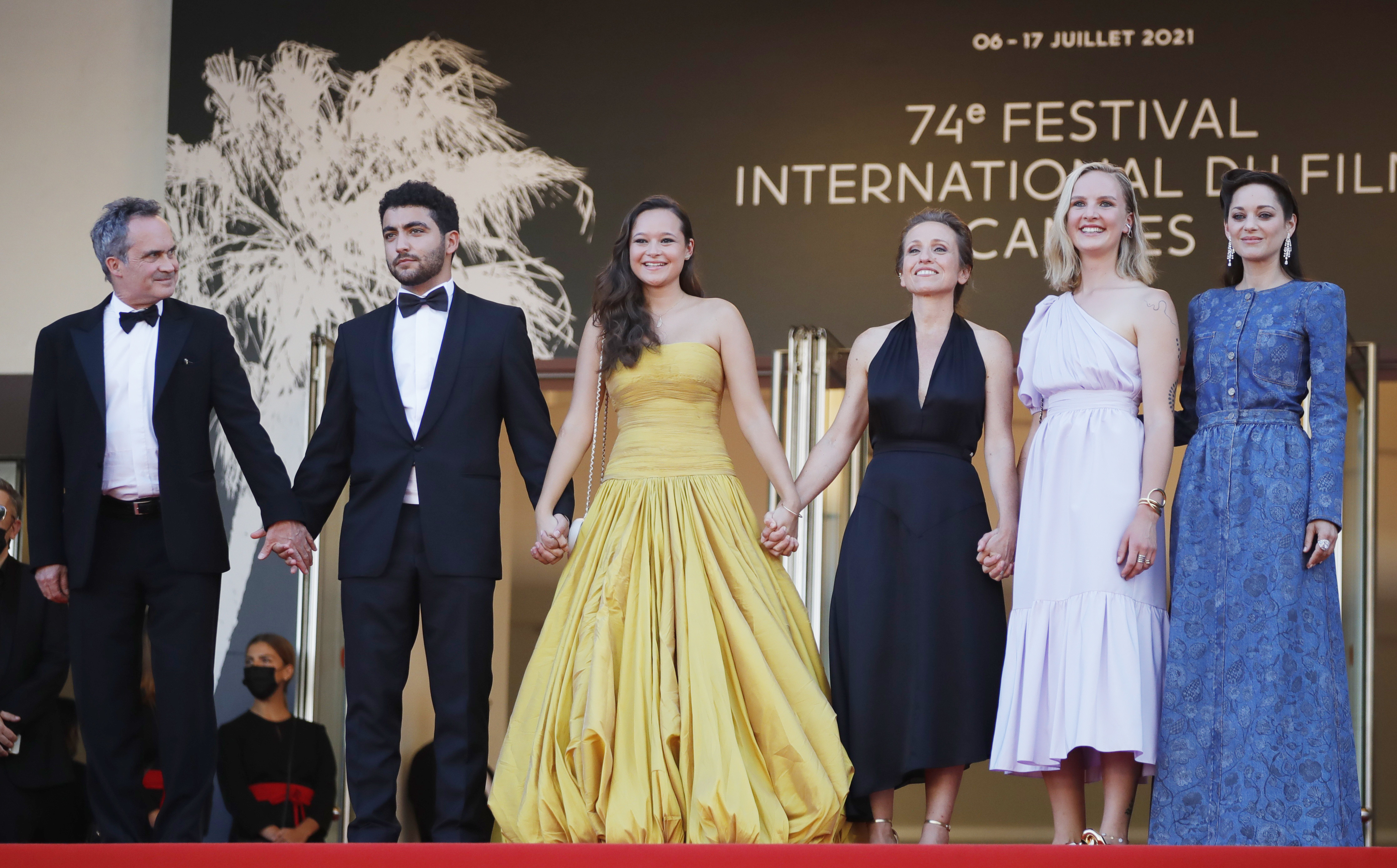 """the 74th Cannes Film Festival - screening of the film """"Bigger Than Us"""" presented as part of Cinema for the Climate - Red Carpet Arrivals - Cannes, France, July 10, 2021. Marion Cotillard, Mary Finn, Flore Vasseur, Melati Wijsen, Mohamad Aljounde and Denis Carot can be seen posing"""