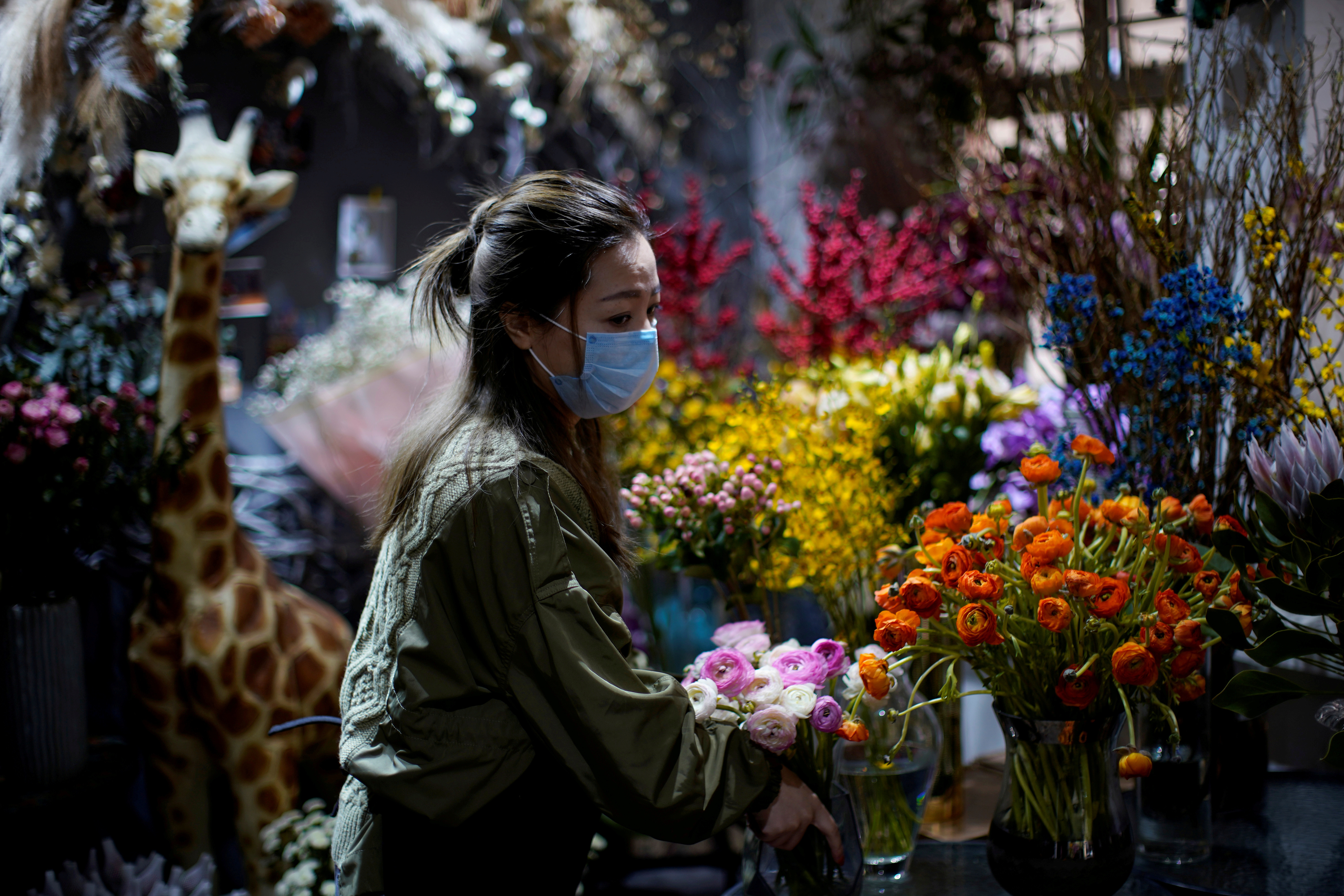 Florist Wang Haiyan, 41, works among flowers inside her shop as the country is hit by an outbreak of the new coronavirus, in Shanghai, China February 5, 2020.  REUTERS/Aly Song     TPX IMAGES OF THE DAY - RC27UE9770YB