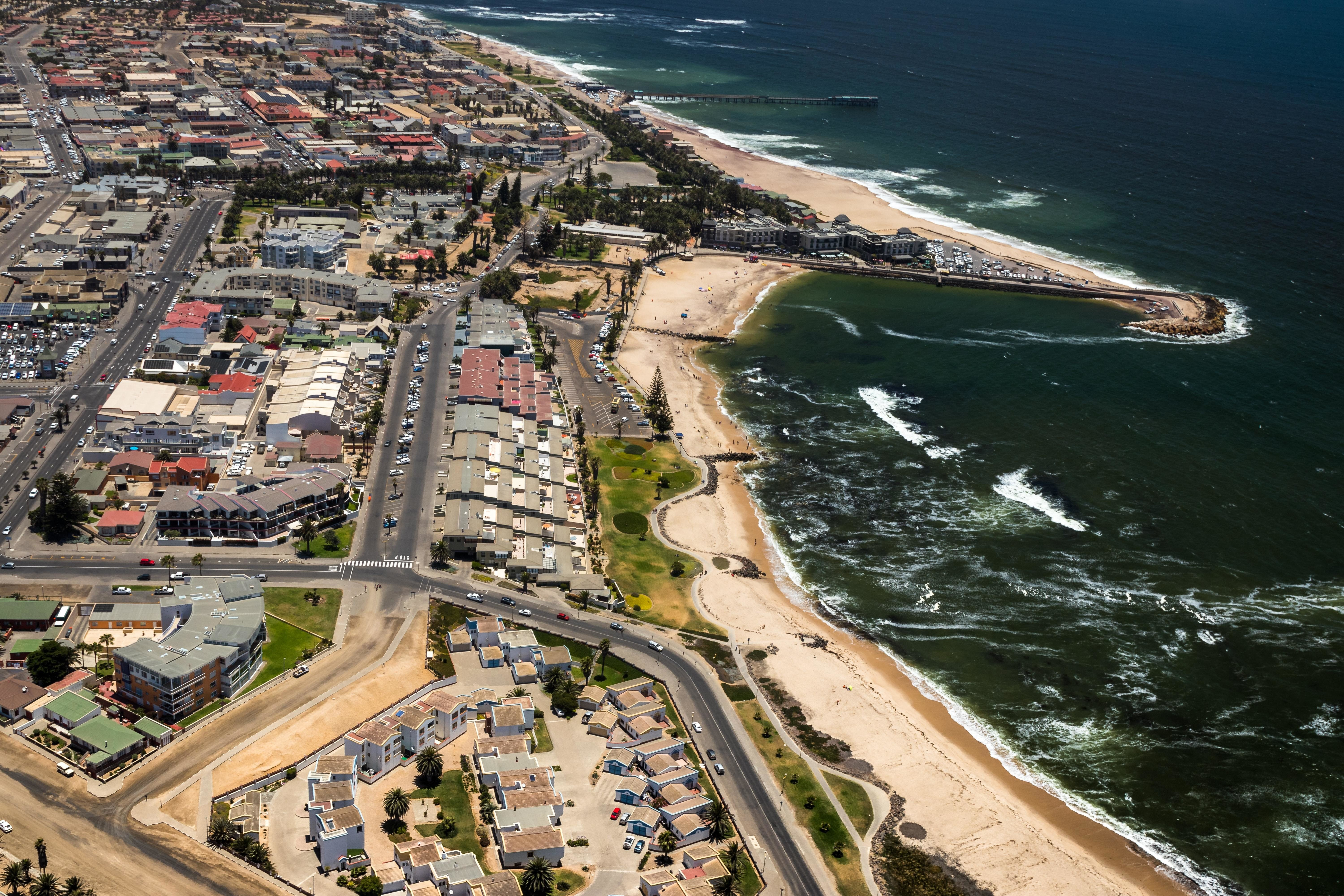 Image a seaside town of Swakopmund in Namibia with the ocean on one side and the town on the other