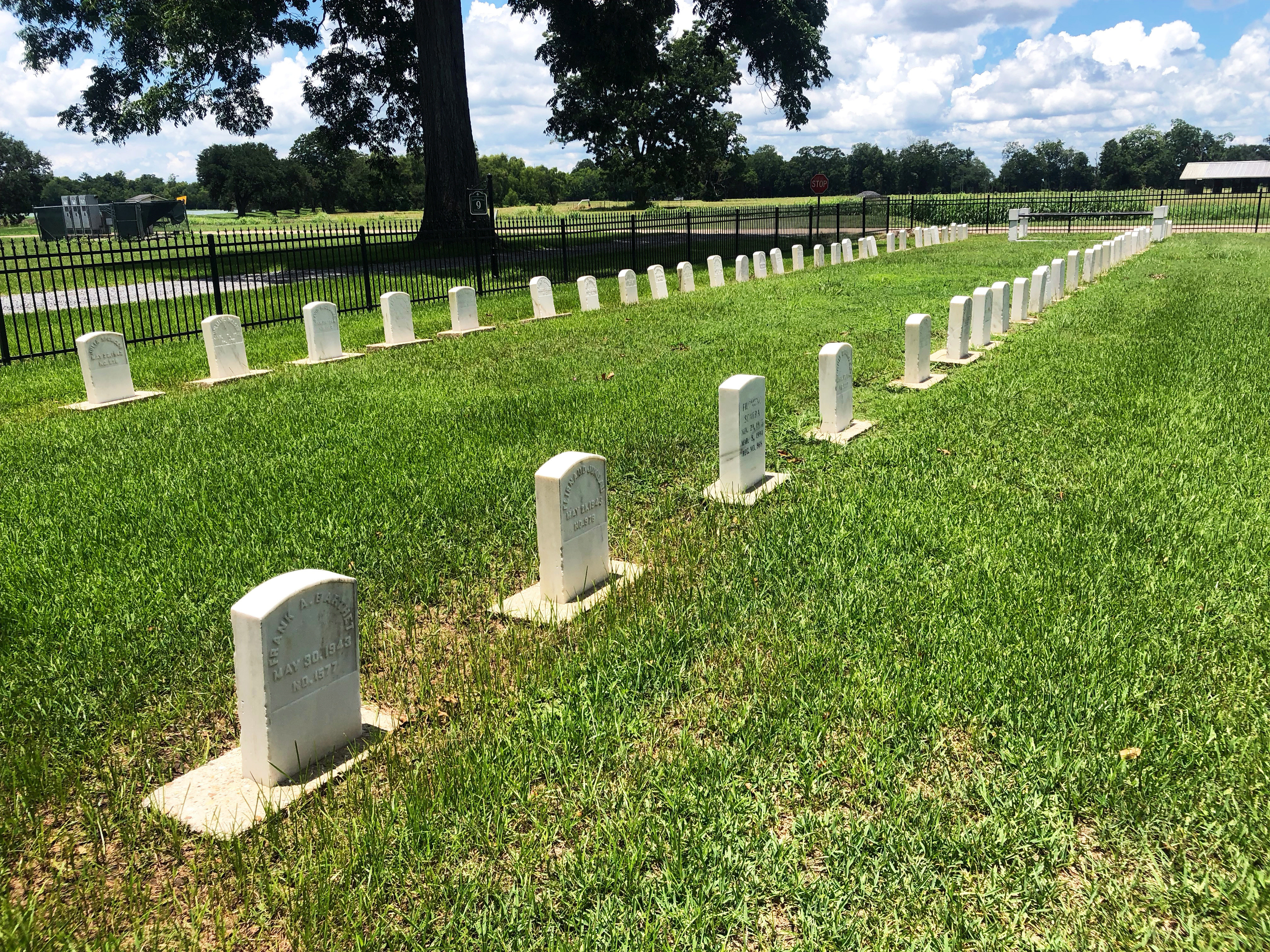 Markes for former leprosy patients line a graveyard in the former leprosy colony at what is now the Gillis W. Long National Guard Center in Carville, Louisiana, U.S., July 6, 2018. Picture taken July 6, 2018.   To match Special Report USA-MILITARY/LOUISIANA   REUTERS/Joshua Schneyer - RC1AF461A070