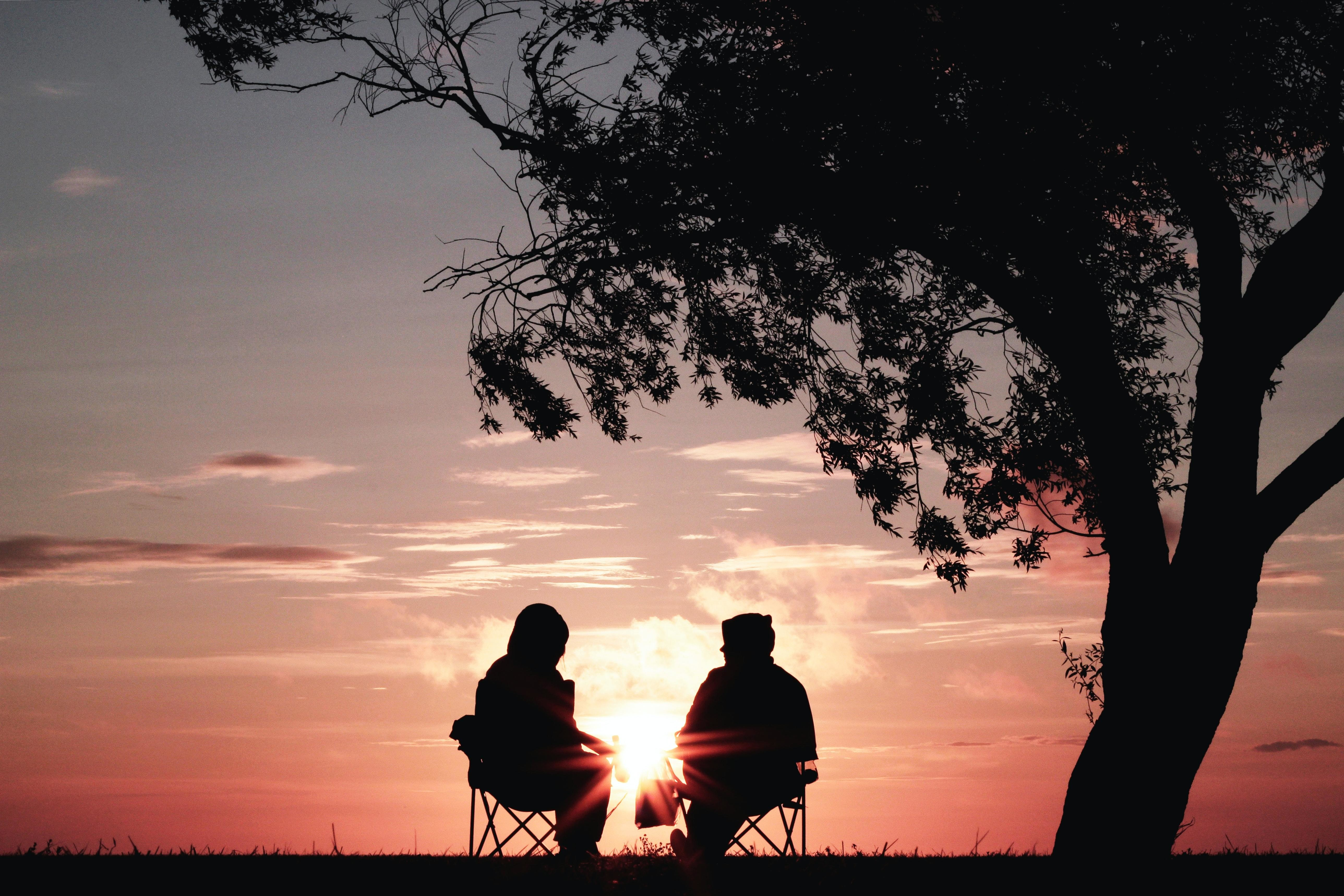 Being a good listener, like these two people here having a conversation, can improve your cognitive resilience.