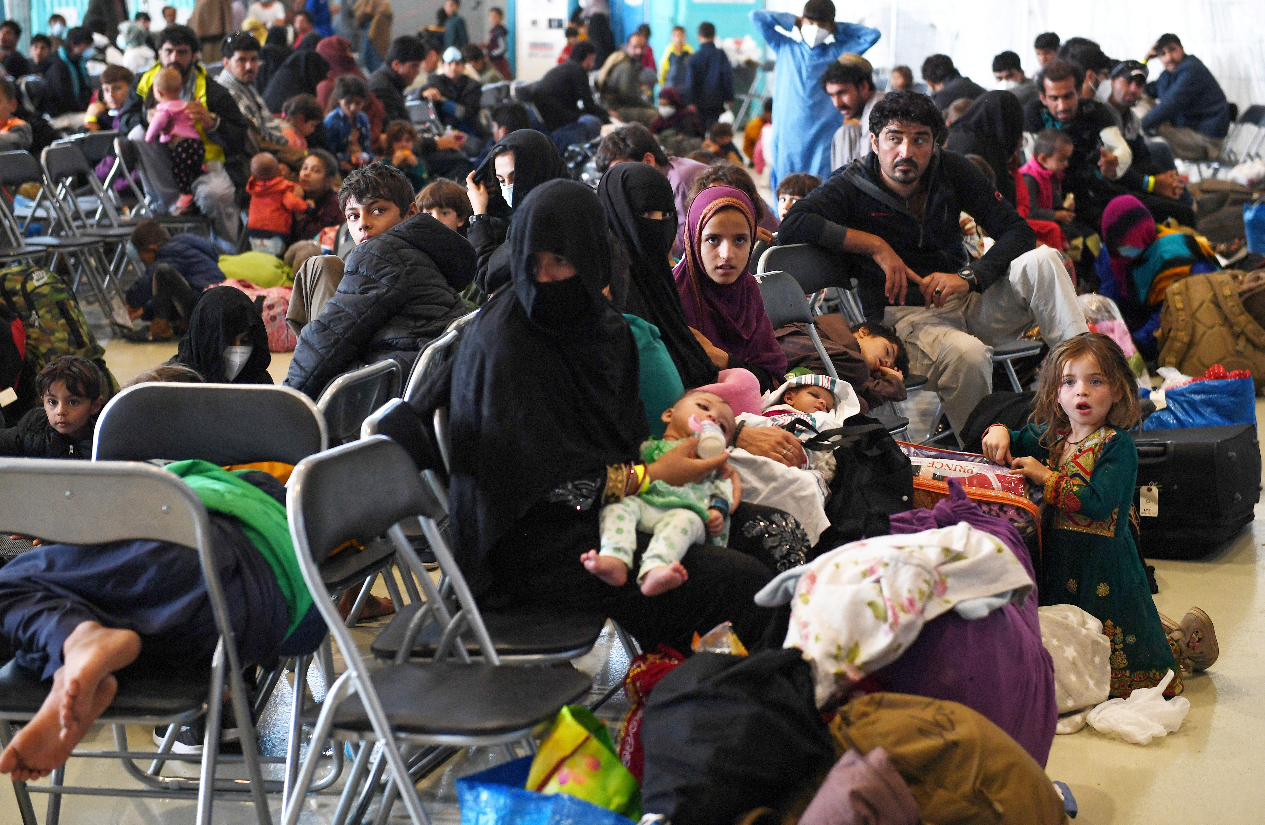 Afghan refugees are processed inside Hangar 5 at Ramstein Air Base in Germany, September 8, 2021. Olivier Douliery/Pool via REUTERS - RC2OLP9XQIQ2