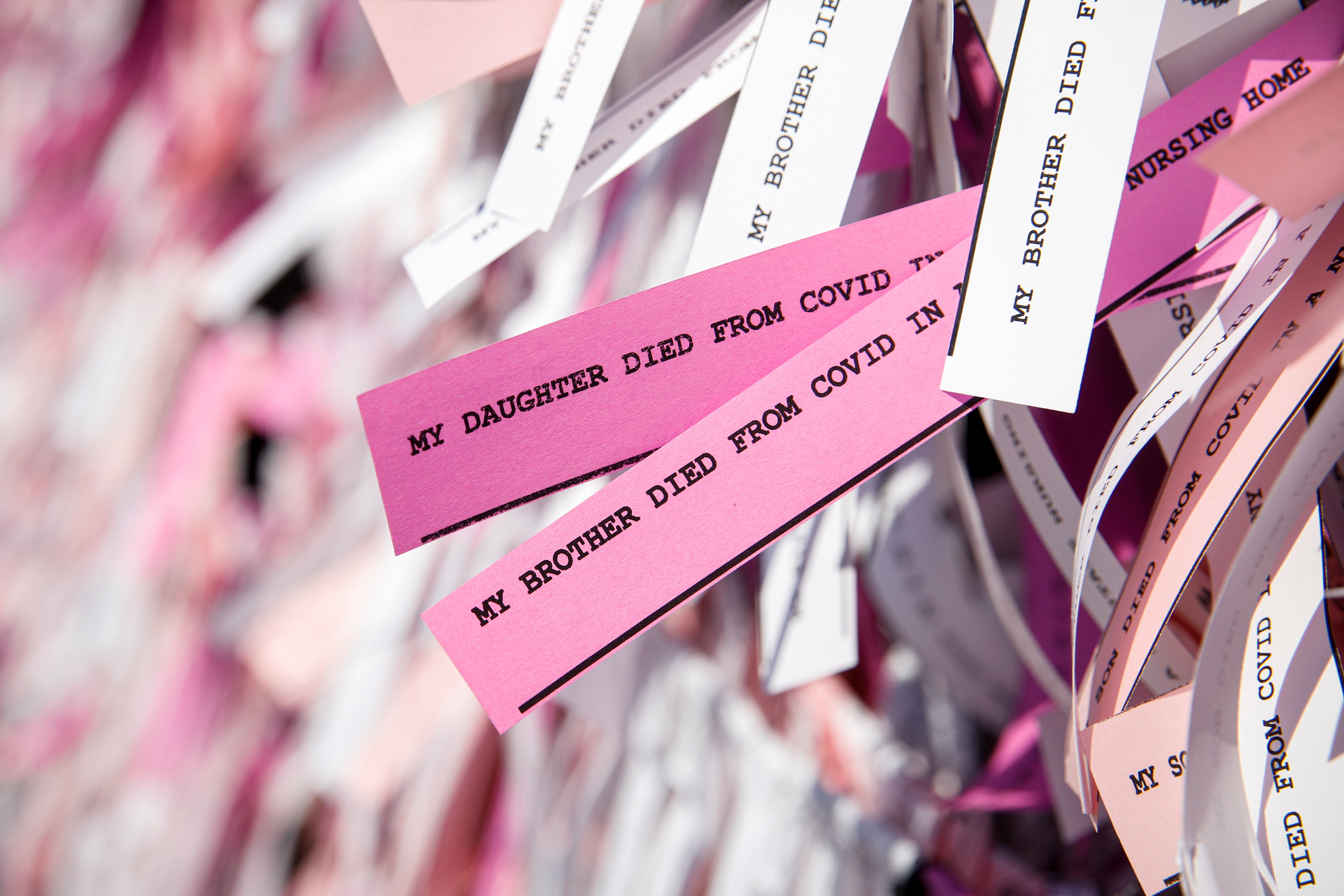 """Messages are seen on ribbons as part of the """"Naming the Lost Memorials,"""" as the U.S. deaths from the coronavirus disease"""