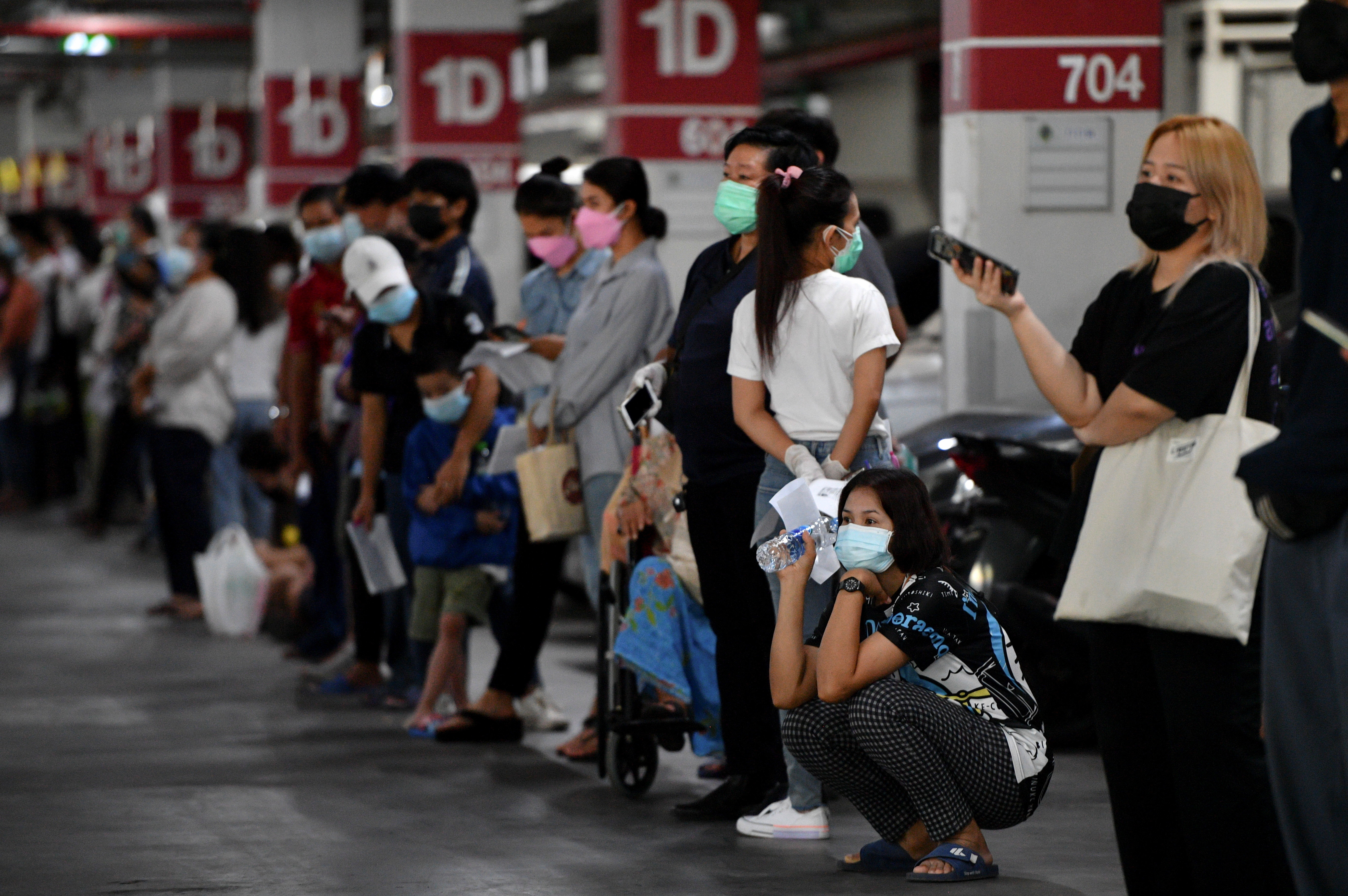 People queue for free coronavirus disease (COVID-19) rapid antigen tests at a mass testing station, as the spread of COVID-19 continues, in Bangkok, Thailand, July 15, 2021. REUTERS/Chalinee Thirasupa - RC2WKO9R80TA