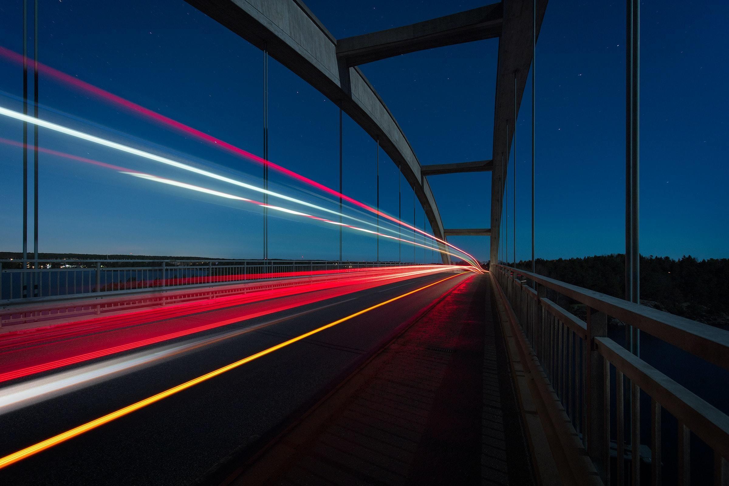 Night, bridge, traffic, car lights red yellow white; long exposure nighttime shot of traffic on bridge; digital highway