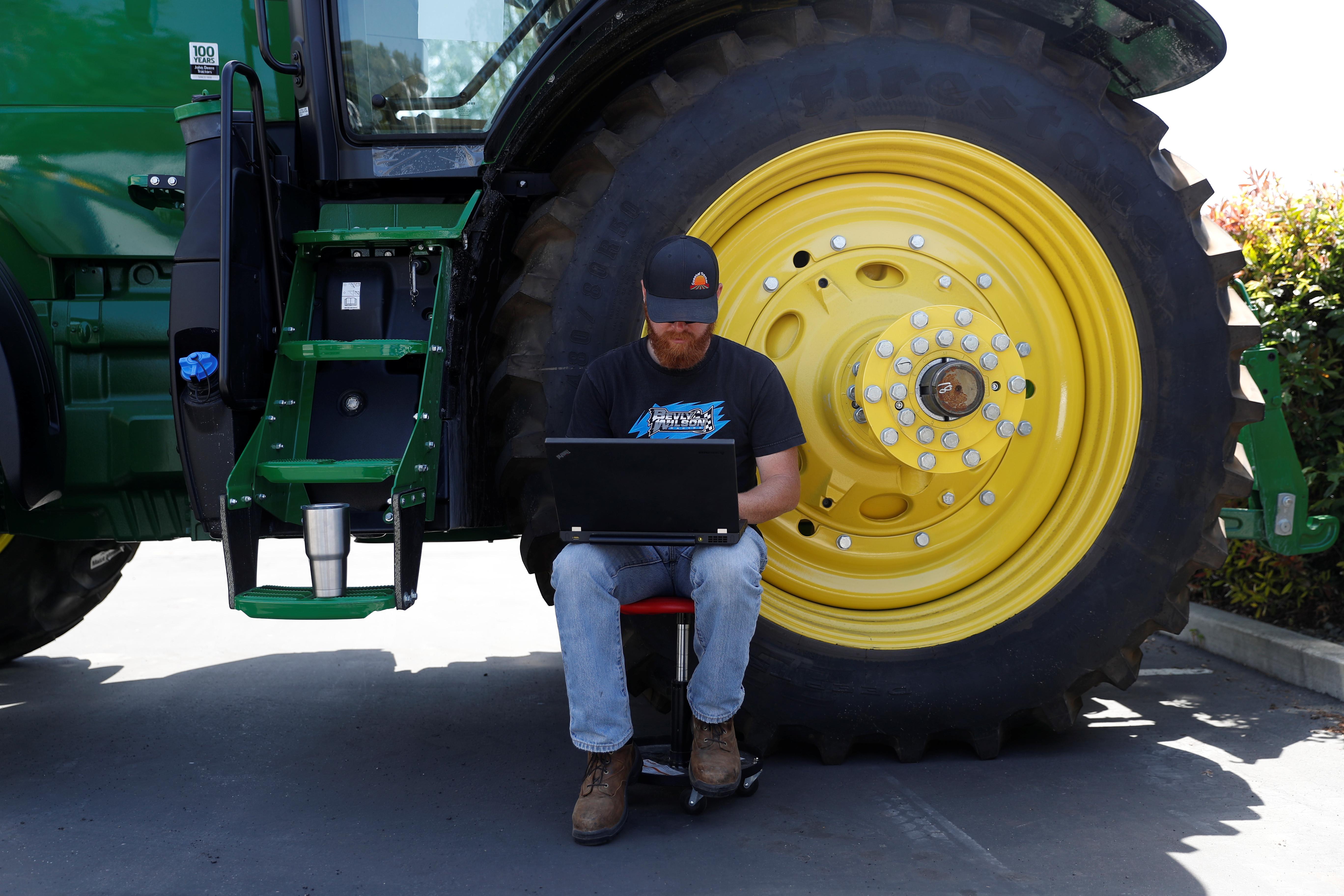 Bryon Majusiak, a senior mechanical engineer, works on his computer on a farm Sunnyvale, California.