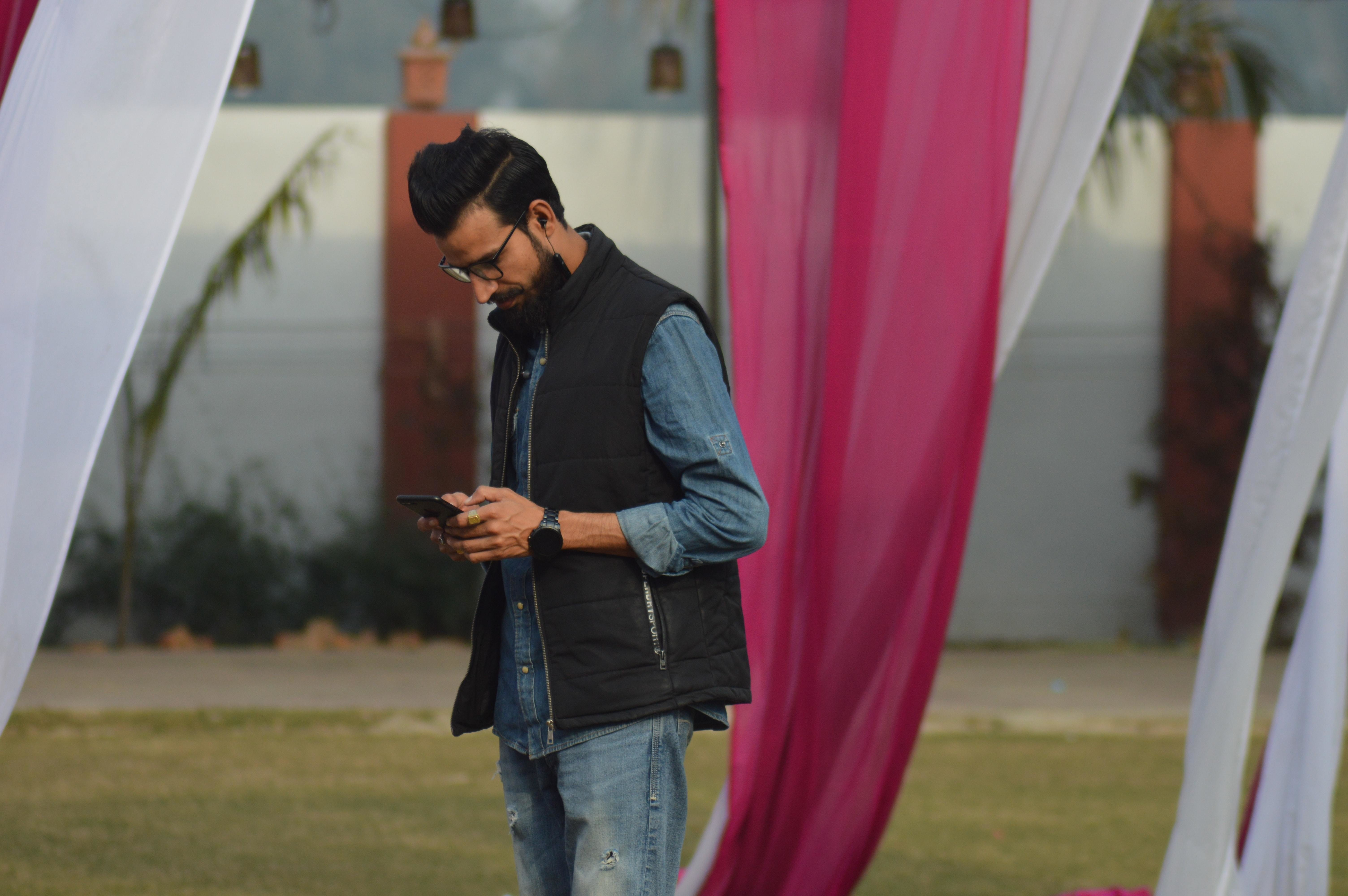 A man in Bijnor, Uttar Pradesh, India, viewing his mobile phone.