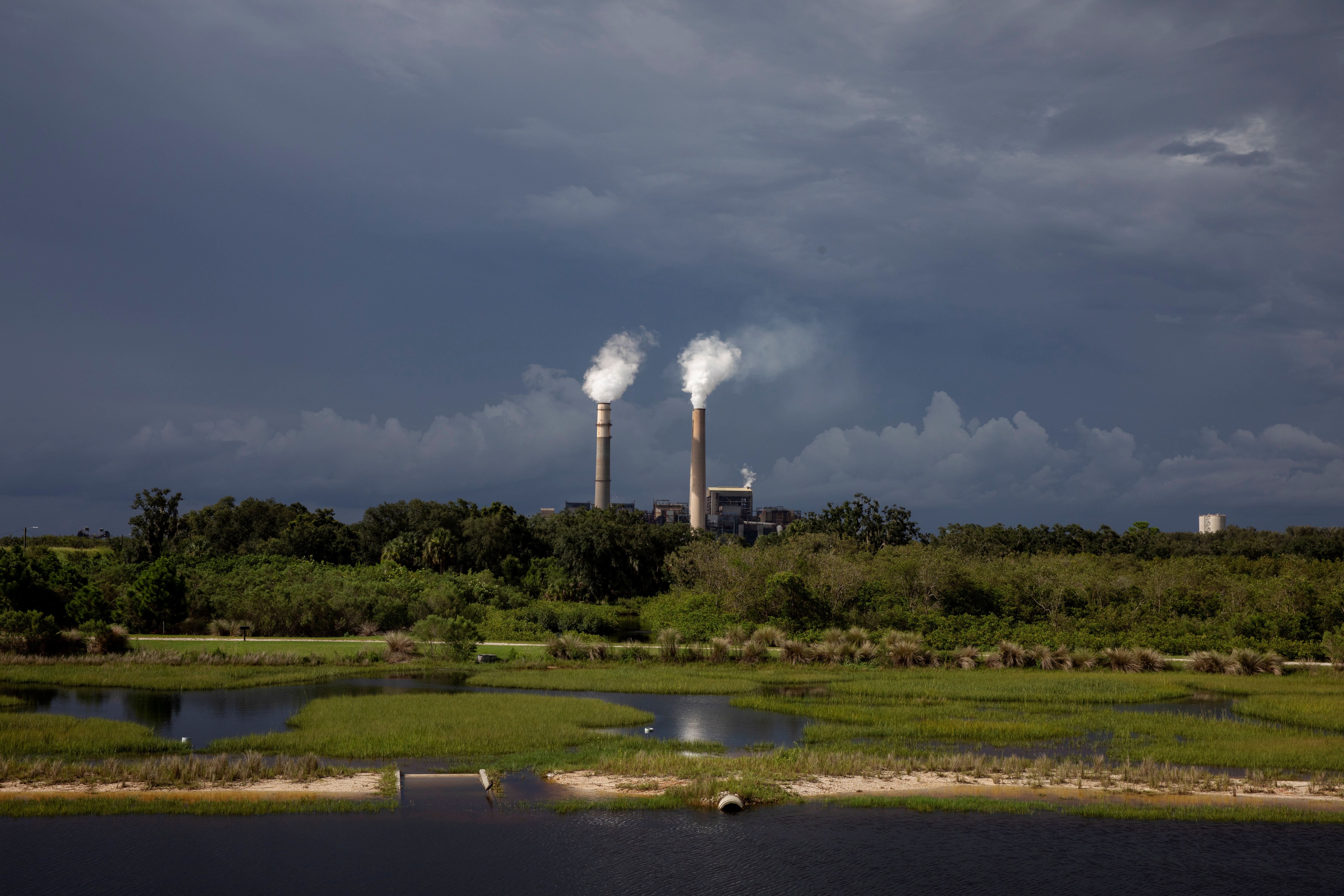 Steam rises out of chimneys at the Big Bend Power Station owned and operated by Tech Energy in Apollo Beach, Florida U.S.,  August 14, 2019
