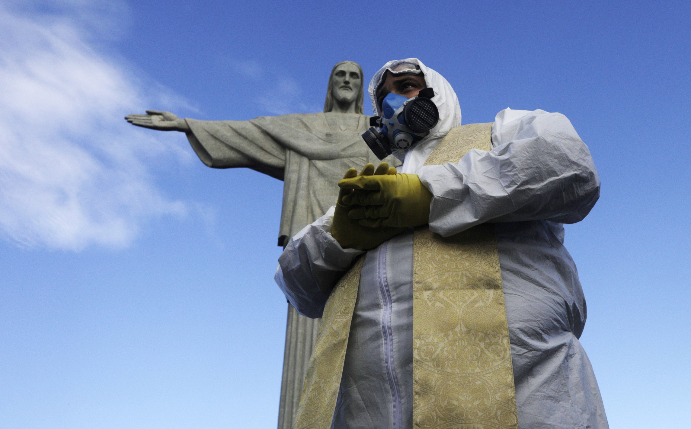 Catholic Priest Omar is pictured as Military members work on disinfection of the Christ the Redeemer statue ahead of its re-opening amid the coronavirus disease (COVID-19) outbreak, in Rio de Janeiro, Brazil, August 13, 2020. REUTERS/Ricardo Moraes     TPX IMAGES OF THE DAY - RC20DI9I3B5C