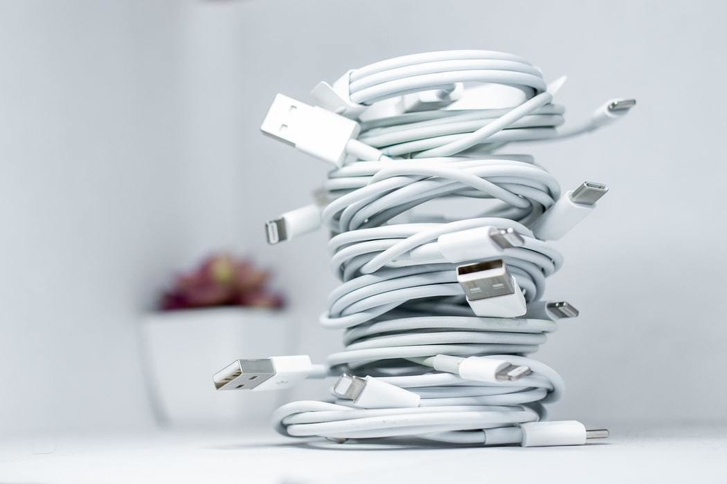Charging wires are pictured tangled up.