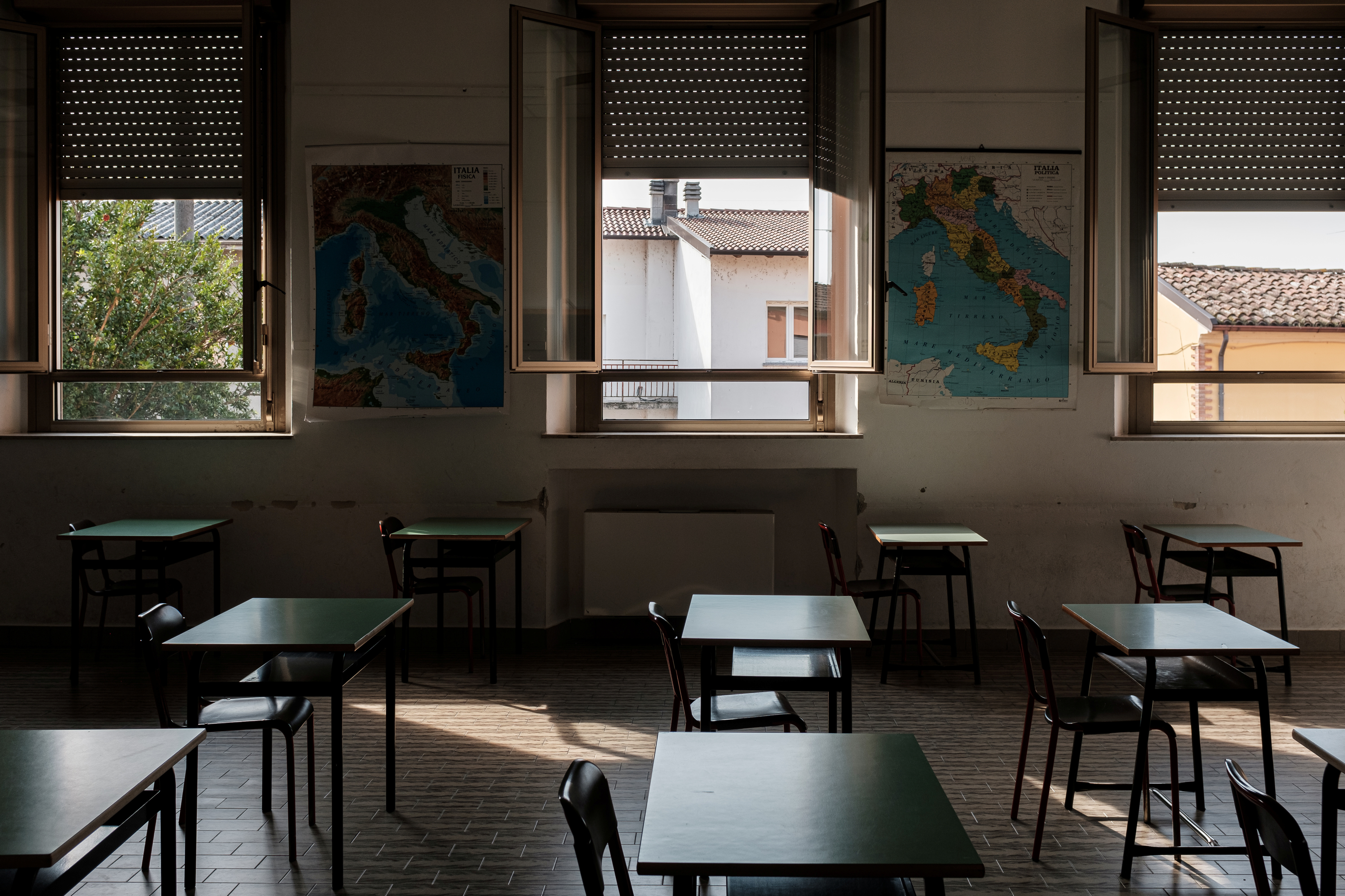 Teacher Marzio Toniolo took this photo of single desks set up in a classroom ahead of the September 14 reopening of his primary school, when children return for the first time since the end of February when Italy's original 'red zone' towns were put under lockdown, adhering to strict regulations to avoid coronavirus disease (COVID-19) contagion, in Santo Stefano Lodigiano,  Italy, September 10, 2020. Picture taken September 10, 2020. REUTERS/Marzio Toniolo - RC2YYI9B1CT3