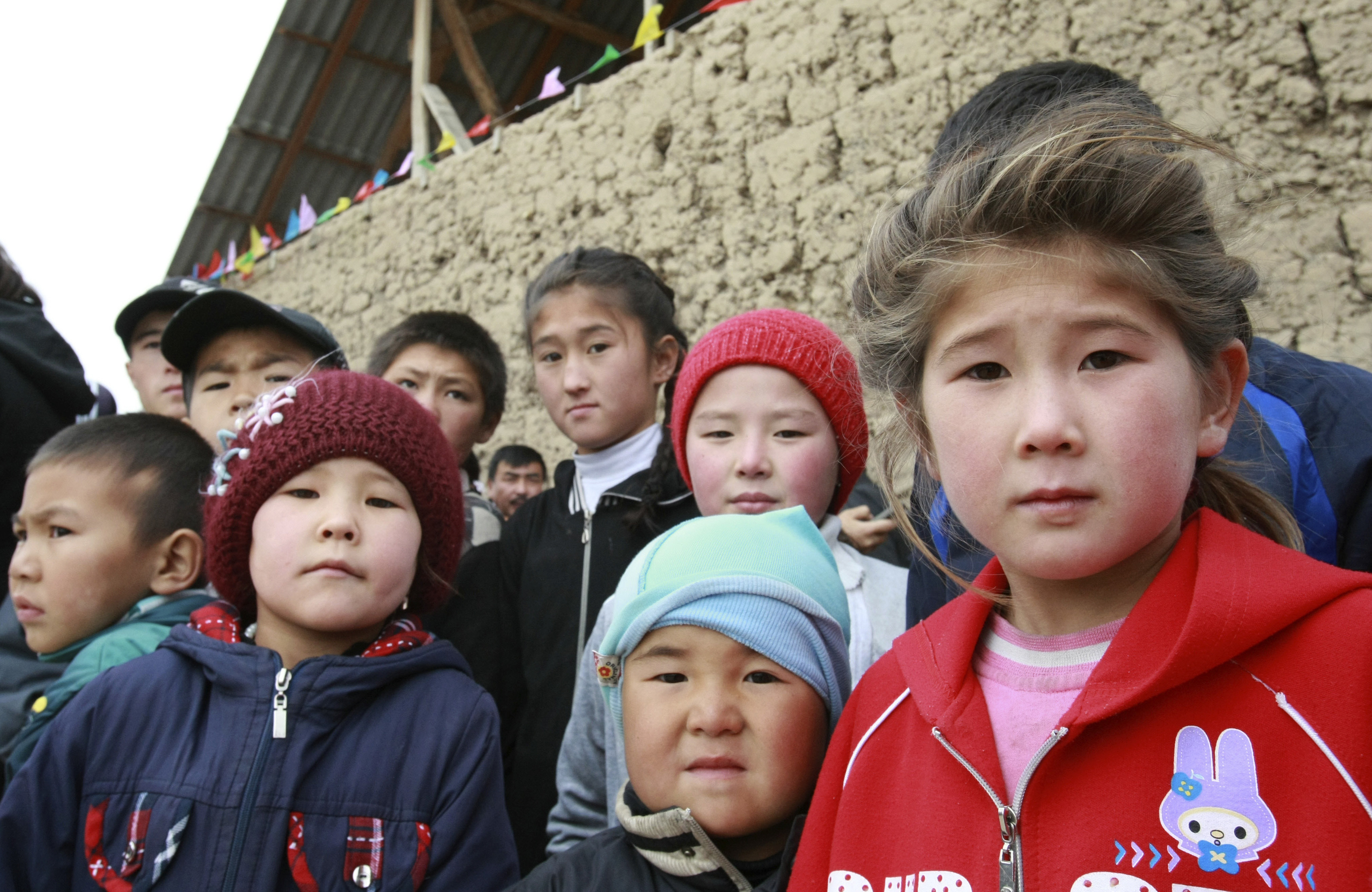 Children wait for a meeting with Kyrgyzstan's Prime Minister and presidential candidate Almazbek Atambayev, who is taking part in his election campaign, in Ak-Zhar district, on the outskirts of the capital Bishkek October 27, 2011. Twenty candidates will vie for the presidency of Kyrgyzstan in an October 30 election -- the final stage of constitutional reforms designed to turn the country into Central Asia's first parliamentary republic.