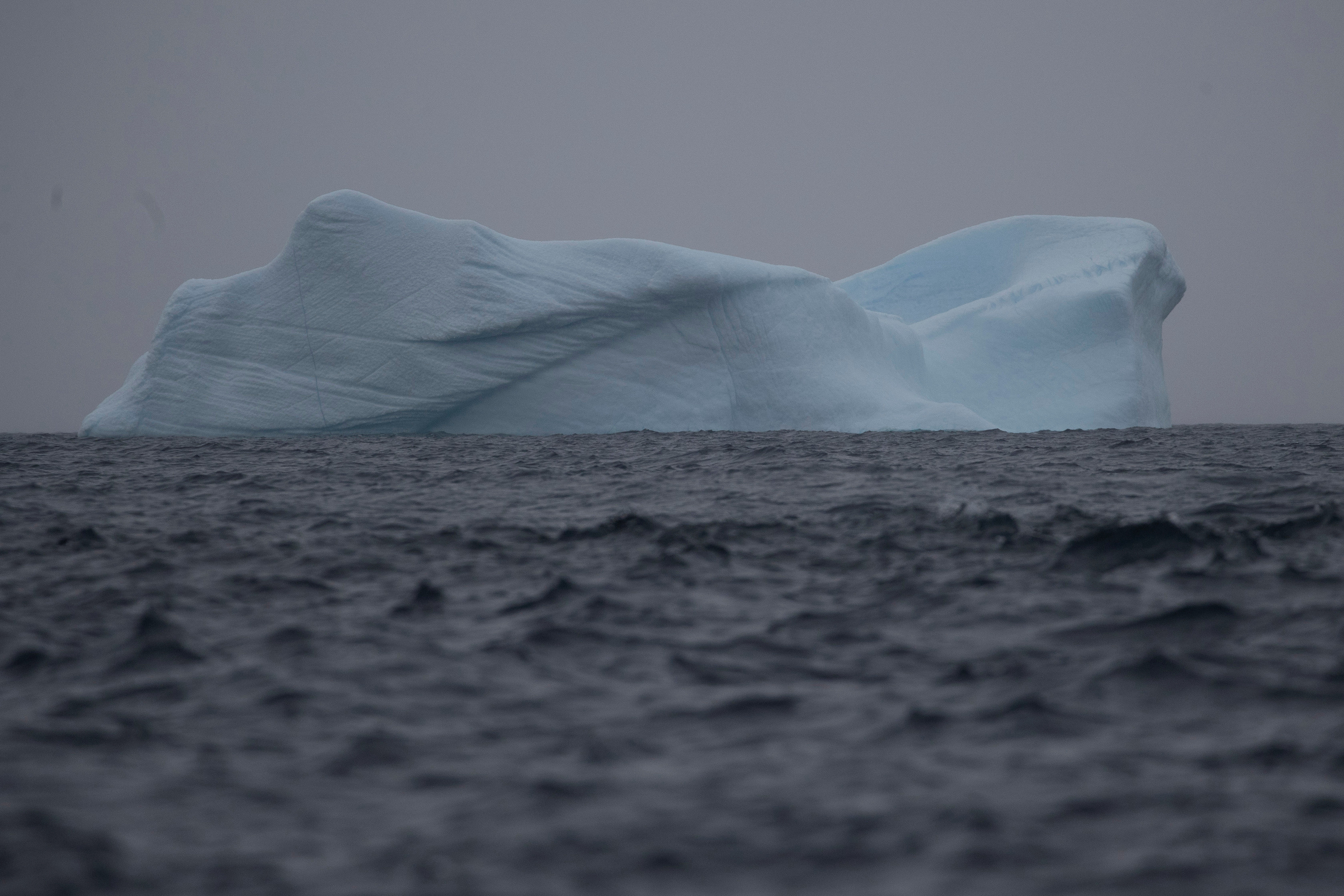 An iceberg floats near Two Hummock Island, Antarctica, February 1, 2020. Picture taken February 1, 2020. REUTERS/Ueslei Marcelino - RC25ZE97LQAU