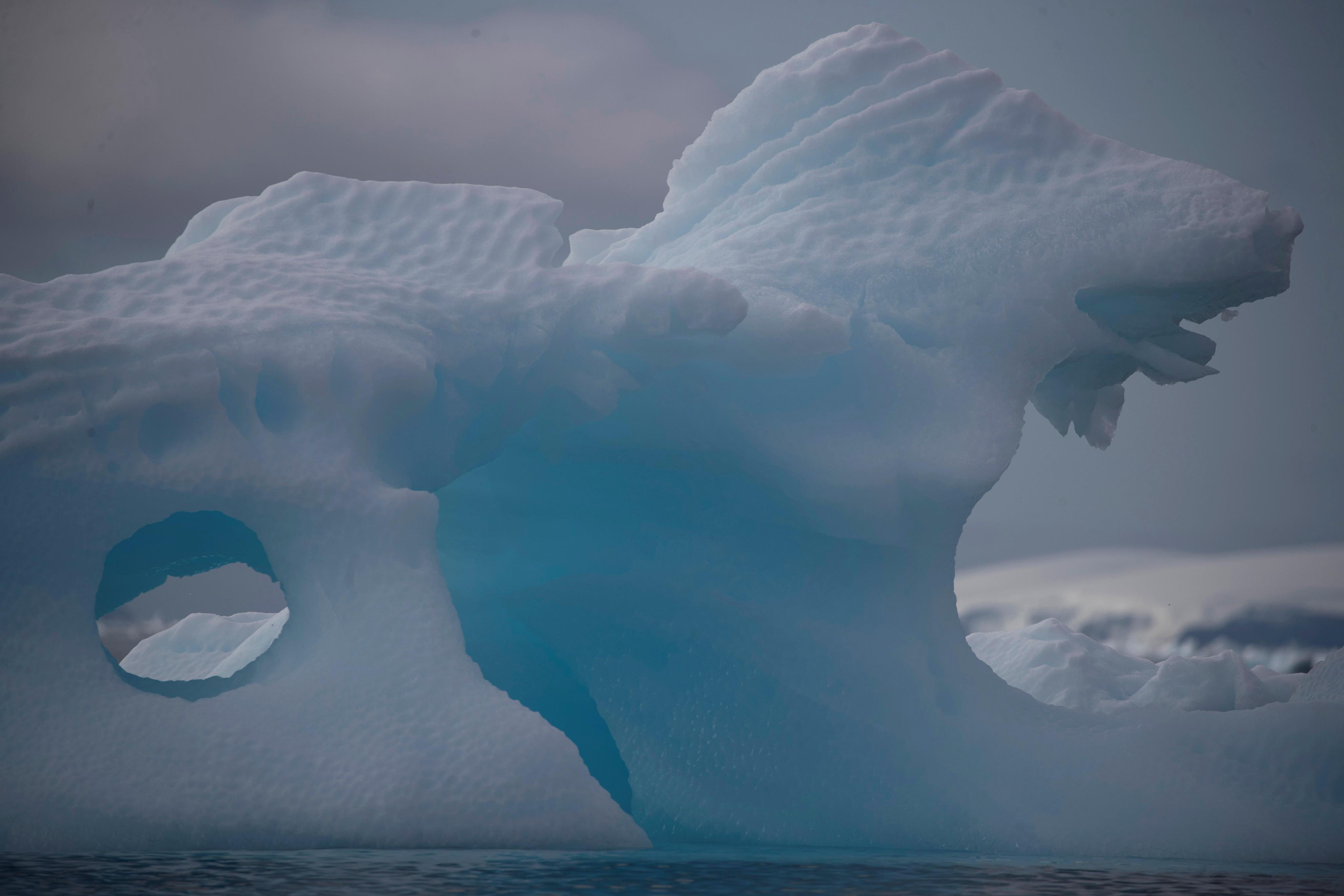 An iceberg floats near Fournier Bay, Antarctica, February February 3, 2020. Picture taken February 3, 2020. REUTERS/Ueslei Marcelino - RC25ZE9G6RR3