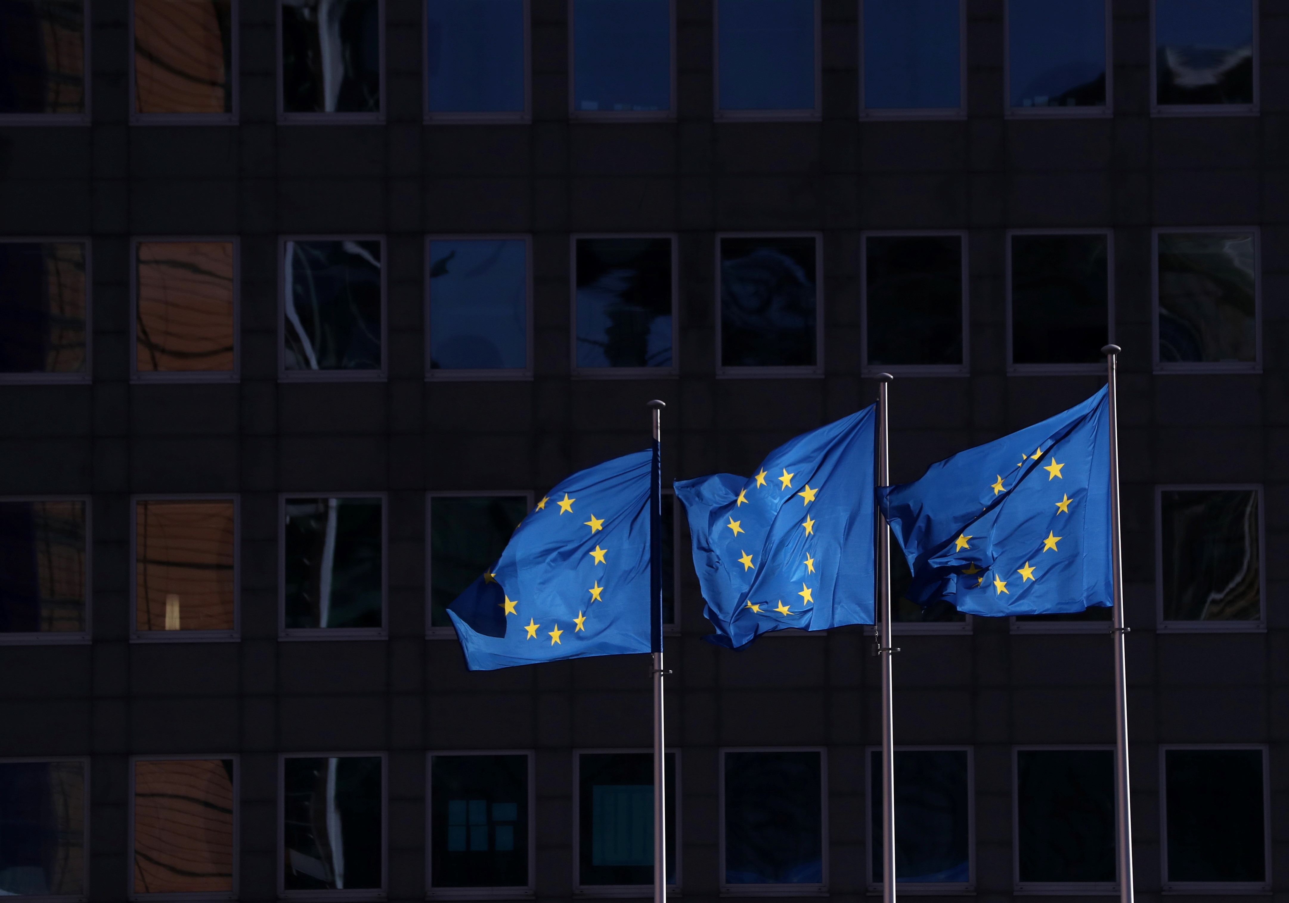 European Union flags fly outside the European Commission headquarters in Brussels, Belgium, February 19, 2020.