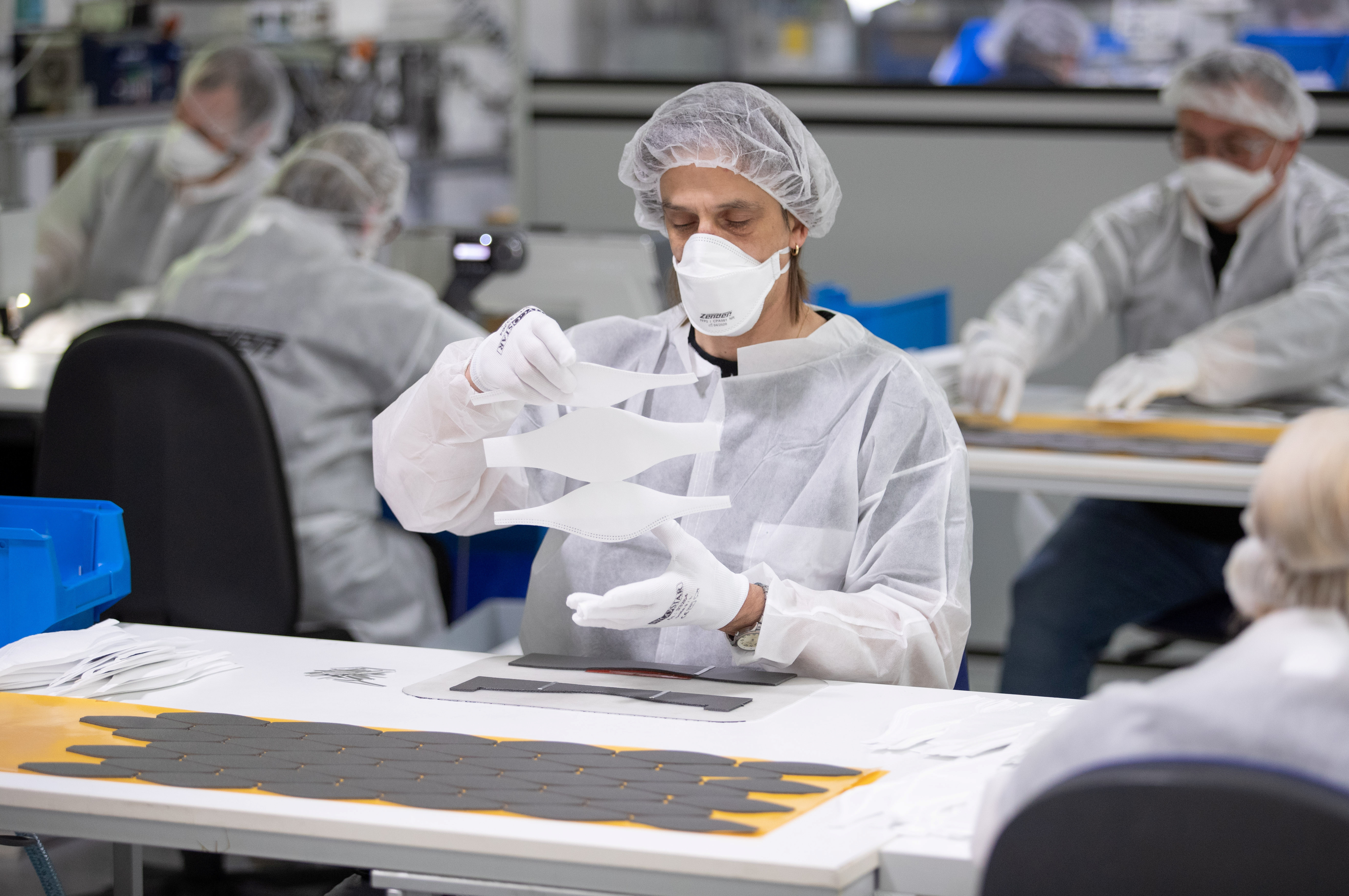 Employees of textile company Zender Germany GmbH, usually an automotive supplier, make protective masks in Osnabrueck, Germany, April 6, 2020, as the spread of the coronavirus disease (COVID-19) continues.      Friso Gentsch/Pool via REUTERS - RC20ZF9Z2HBC