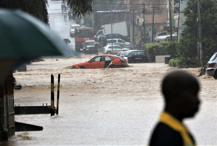 A flooded street is seen in Palmeraie, a neighbourhood of Abidjan, Ivory Coast, June 25, 2020. REUTERS/Thierry Gouegnon