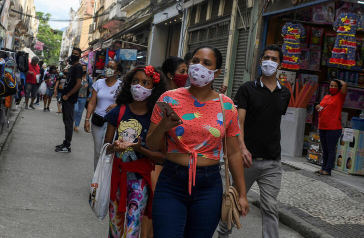 People wear protective masks as they walk at a popular shopping street, as the city eases restrictions and allows commerce to open, amid the coronavirus disease (COVID-19) outbreak in Rio de Janeiro, Brazil June 29, 2020.