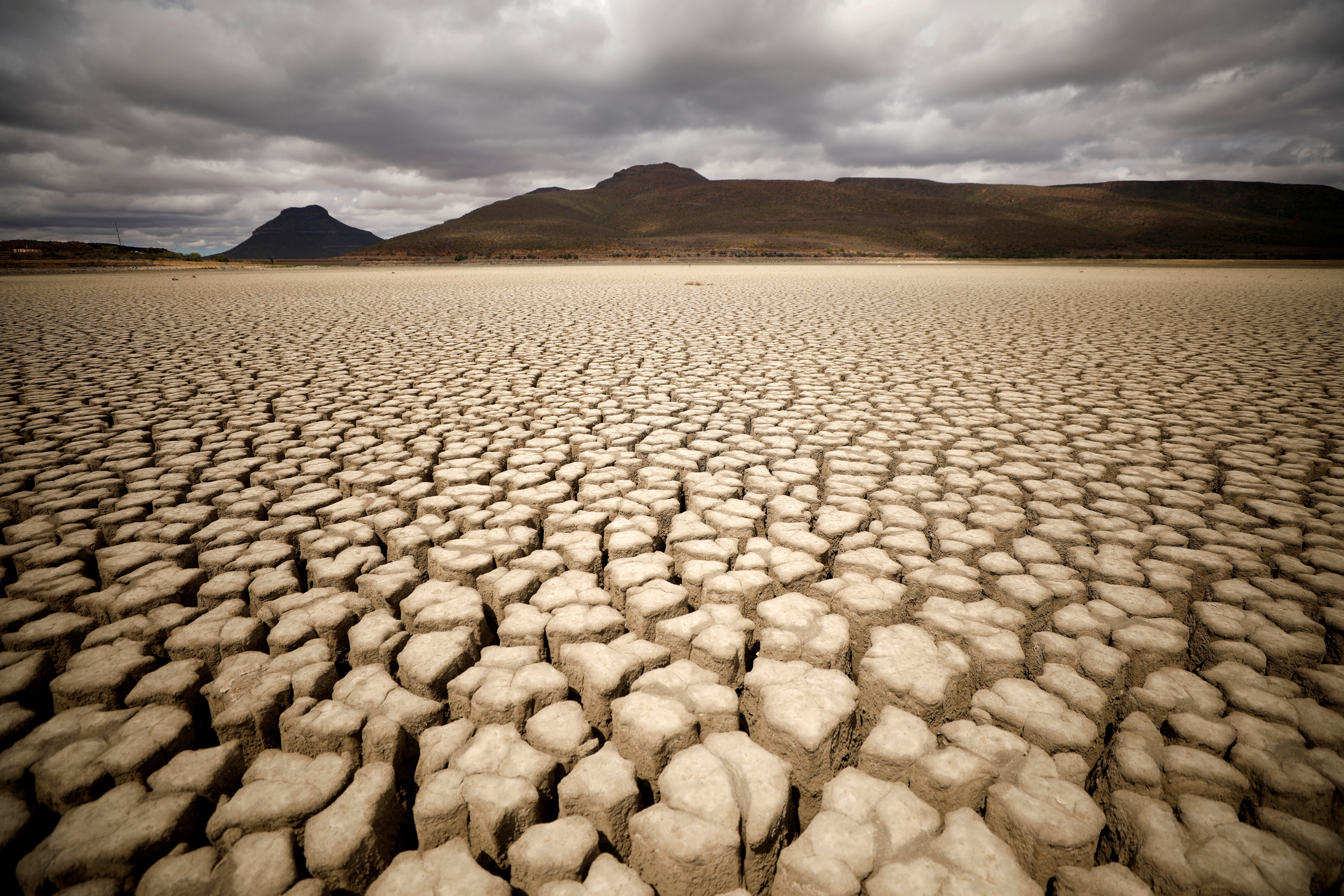 Clouds gather but produce no rain as cracks are seen in the dried up municipal dam in drought-stricken Graaff-Reinet, South Africa, November 14, 2019. Picture taken November 14, 2019. REUTERS/Mike Hutchings     TPX IMAGES OF THE DAY - RC2WKD9A6VC9